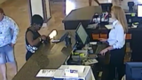 Thief slips into sleeping family's hotel room; steals wallet for shopping spree