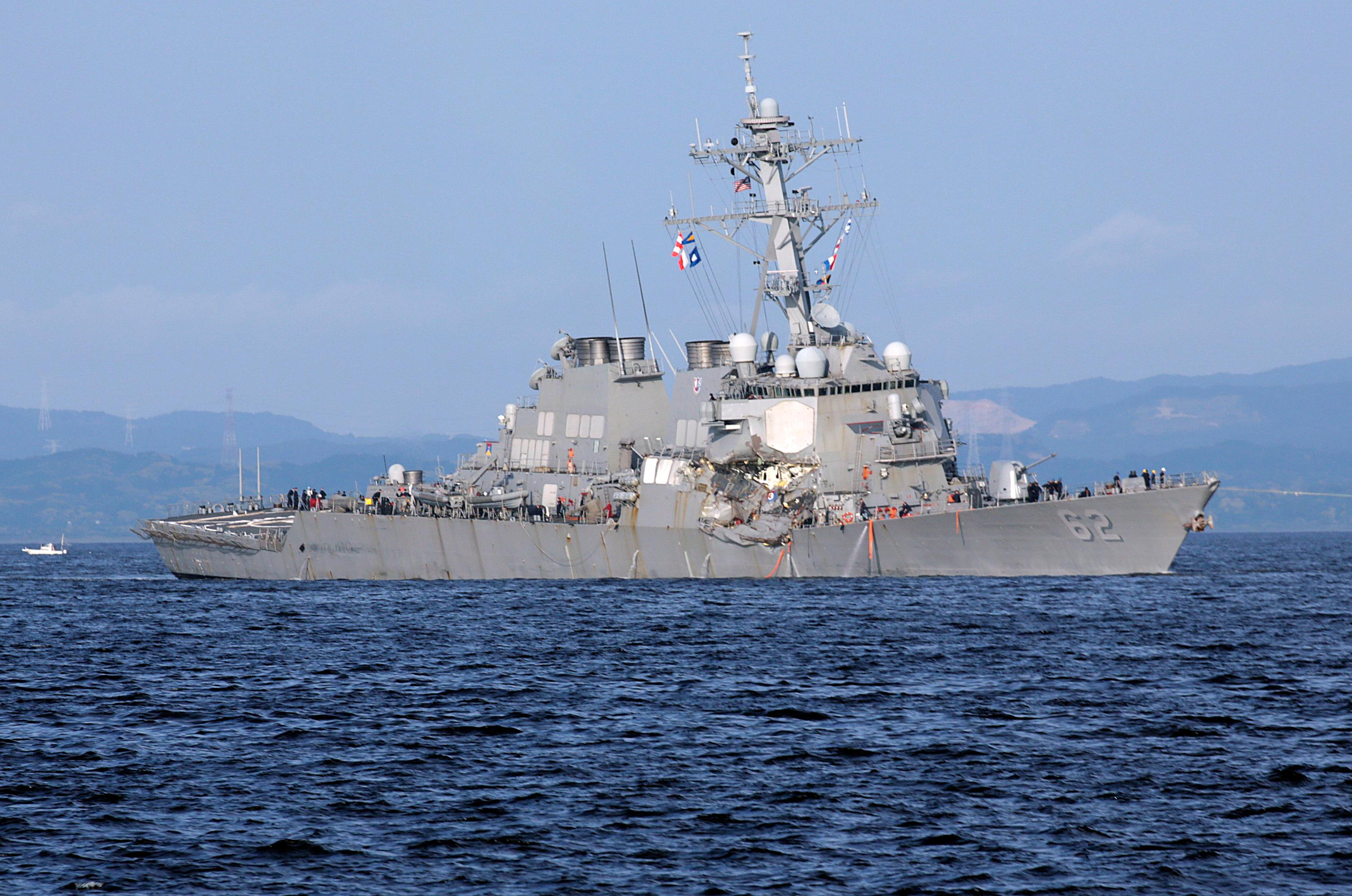 The damaged USS Fitzgerald is seen near the U.S. Naval base in Yokosuka, southwest of Tokyo, after the U.S. destroyer collided with the Philippine-registered container ship ACX Crystal in the waters off the Izu Peninsula Saturday, June 17, 2017. Crew members from the destroyer USS Dewey were helping stabilize the damaged USS Fitzgerald after its collision off the coast of Japan before dawn Saturday, leaving seven sailors missing and at least three injured. (AP Photo/Eugene Hoshiko)