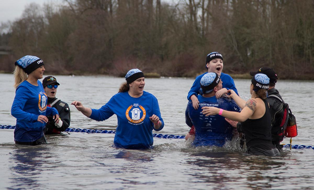 Participants wade through the frigid water at the annual Special Olympics Polar Plunge at Maurie Jacobs Park in Eugene. With over 250 plungers diving into the Willamette River, participants look to surpass $412,000, which was last years total. Eugene is one of five locations around Oregon that hosts the plunge, but is also a nationwide event. The funds raised by today�s plunge will go towards assisting Oregon Special Olympic teams. Photos by Whitney Bradshaw, Oregon News Lab