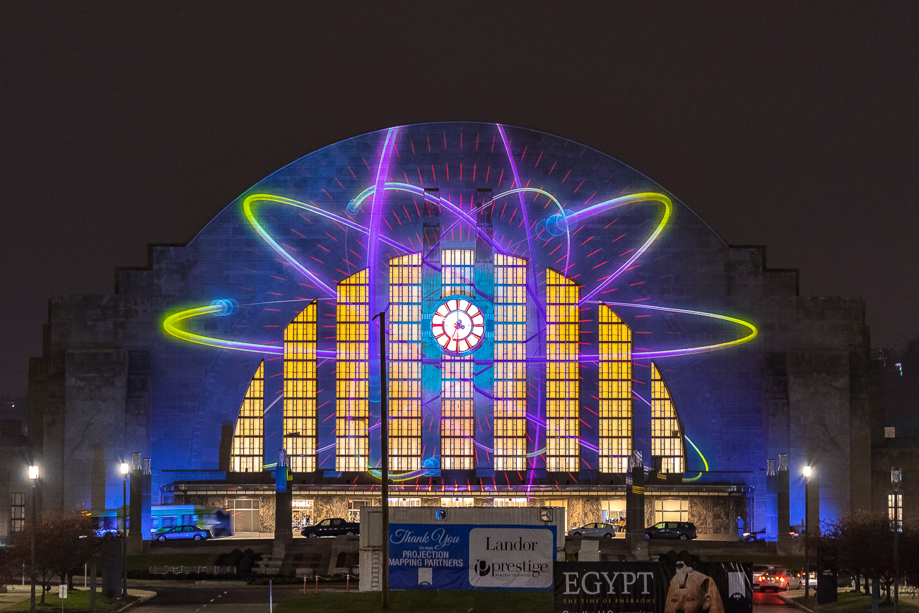 "After the museum reopened, Landor Associates projected a daily light show on the facade of the Terminal. Each night had a different theme. First published on November 29 in ""The Best of Union Terminal's Week of Nightly Light Shows"" / Image: Phil Armstrong"