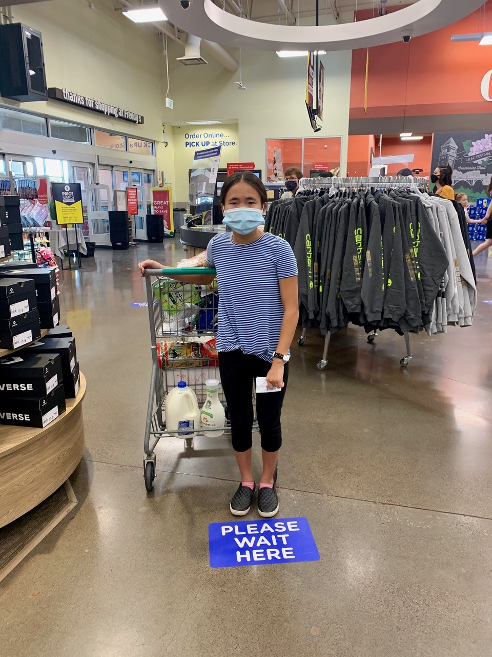 Take photos of things 'you've never seen happen before' (like wearing masks to the grocery store) to document your experience. (Image: Stacy Julian)
