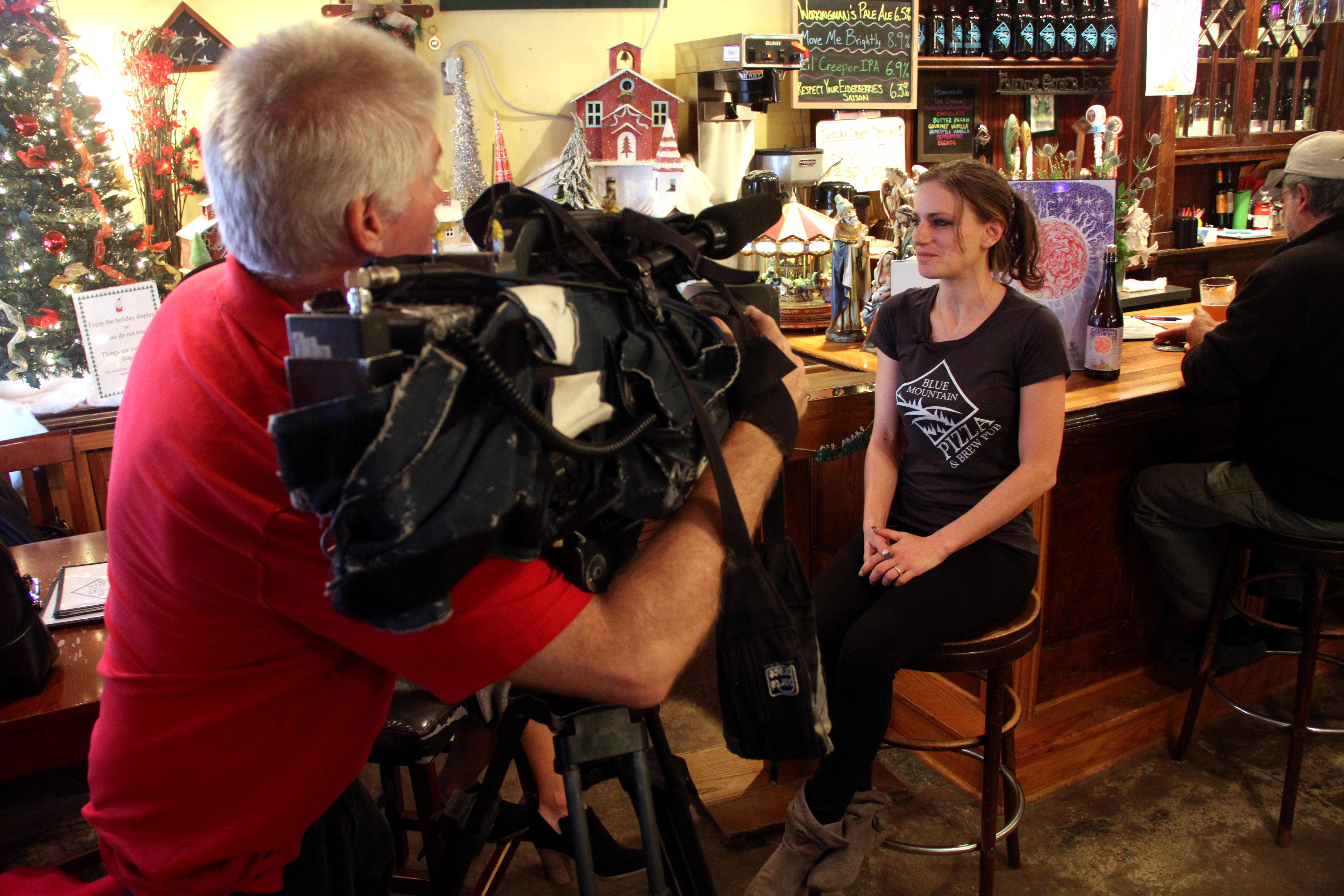 Adrienne Tasin of Blue Mountain Pizza speaks with News 13 in Dec. 2017. (Photo credit: WLOS Staff)