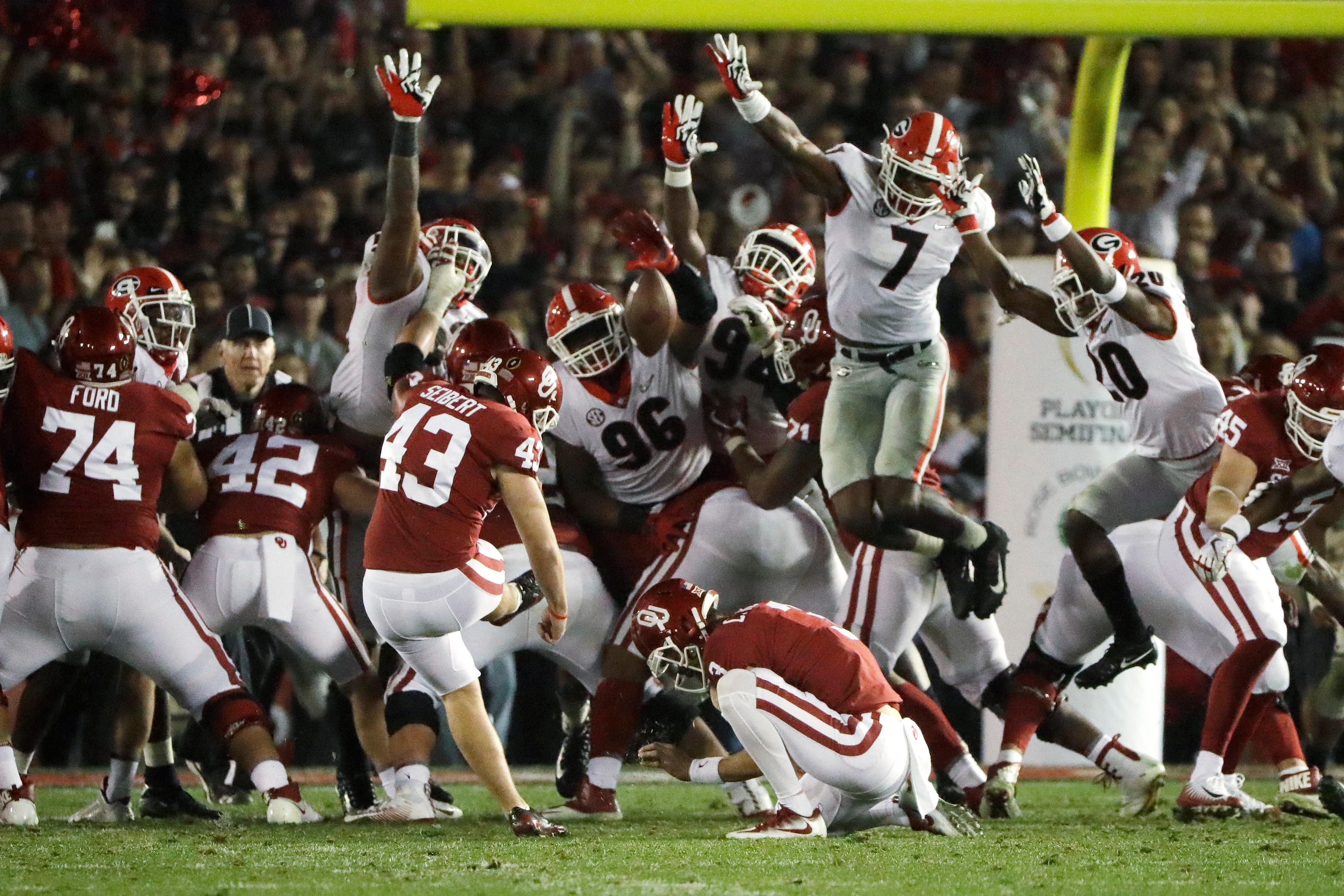 Georgia linebacker Lorenzo Carter (7) blocks a field goal attempted by Oklahoma kicker Austin Seibert (43) during overtime in the Rose Bowl NCAA college football game, Monday, Jan. 1, 2018, in Pasadena, Calif. Georgia won 54-48. (AP Photo/Gregory Bull)