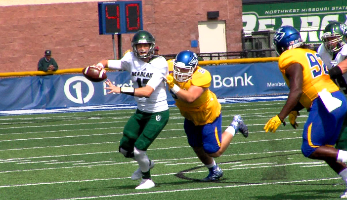 UNK senior defensive lineman Sam Stoltenberg (94) pressures Northwest Missouri State quarterback Zach Martin on Sept. 16, 2017 (KHGI)