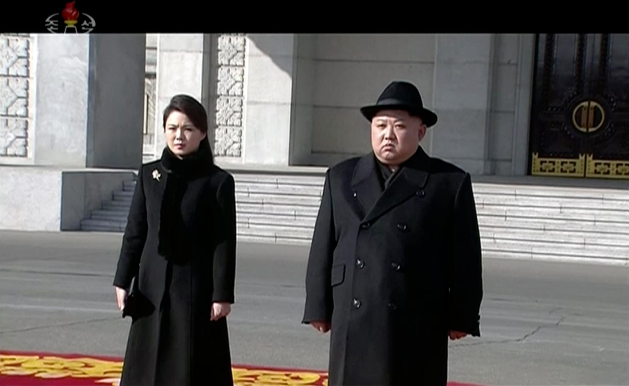In this image made from video released by KRT on Feb. 8, 2018,  North Korean leader Kim Jong Un, right, and his wife Ri Sol Ju arrive at a military parade in Pyongyang, Thursday, Feb. 8 2018.  North Korea held a military parade and rally on Kim Il Sung Square on Thursday, just one day before South Korea holds the opening ceremony for the Pyeongchang Winter Olympics. (KRT via AP Photo)