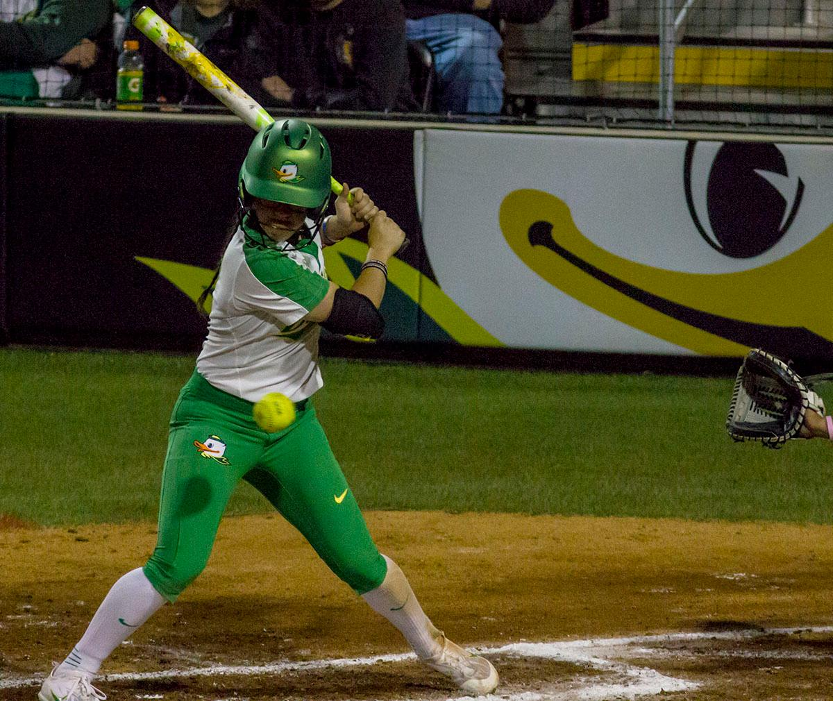 Ducks right-fielder Danica Mercado (#2) takes a pitch. The No. 3 Oregon Ducks defeated the University of Illinois Chicago Flames 13-0 with the run-rule on Saturday night at Jane Sanders Stadium. The Ducks scored in every inning and then scored nine runs at the bottom of the fourth. The Oregon Ducks are now 22-0 in NCAA regional games. The Oregon Ducks play Wisconsin next on Saturday, May 20 at 2pm at Jane Sanders Stadium. Photo by Aaron Alter, Oregon News Lab