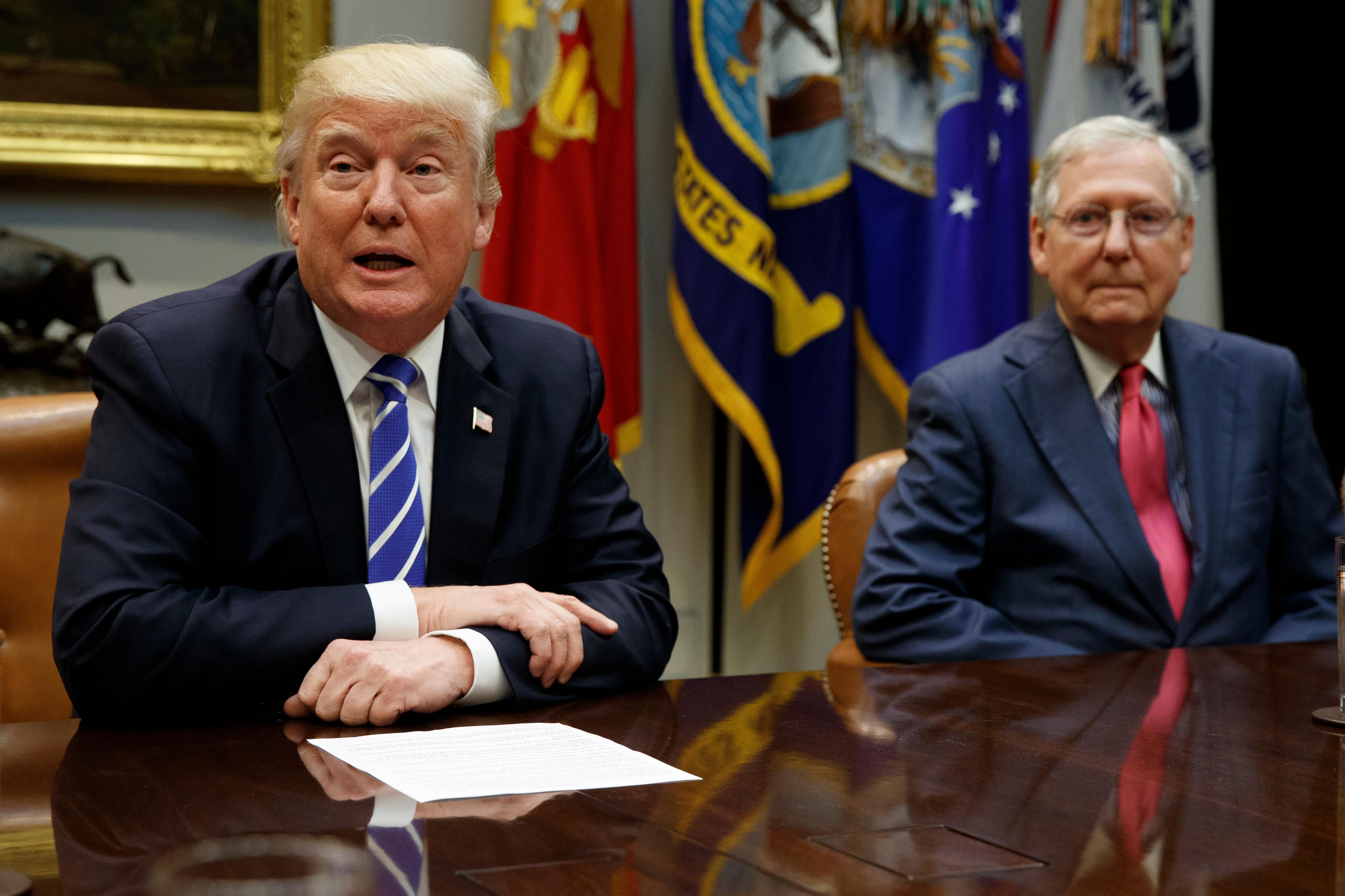 Senate Majority Leader Mitch McConnell, R-Ky., right, listens as President Donald Trump speaks during a meeting with congressional leaders and administration officials on tax reform, in the Roosevelt Room of the White House, Tuesday, Sept. 5, 2017, in Washington. (AP Photo/Evan Vucci)