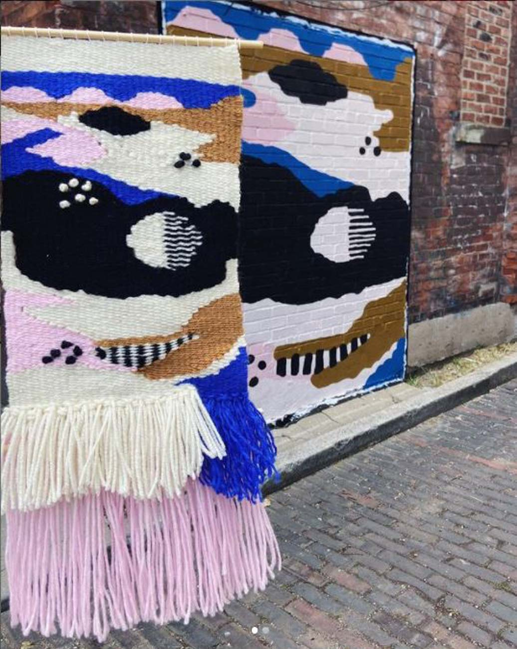 Genevieve has worked for ArtWorks, as well, painting a mural at the corner of 4th and Vine Streets. She's also made a fiber art installation as part of their program to brighten up local storefronts. / Image courtesy of Genevieve Lavalle of BlackOlive Art // Published: 12.26.