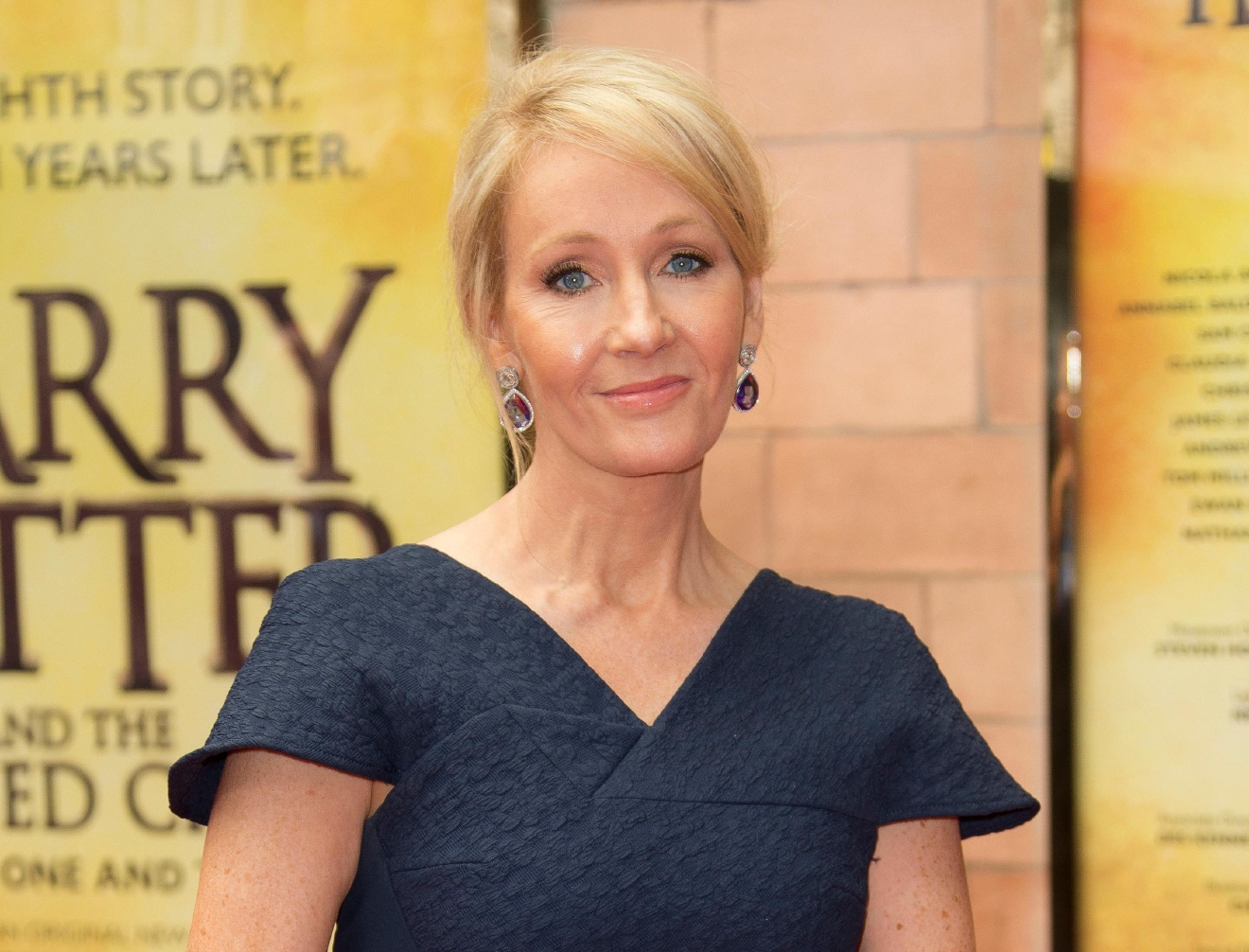 "FILE - In this July 30, 2016, file photo, writer J.K. Rowling poses for photographers upon arrival at gala performance of ""Harry Potter and the Cursed Child,"" in central London. (Photo by Joel Ryan/Invision/AP, File)"