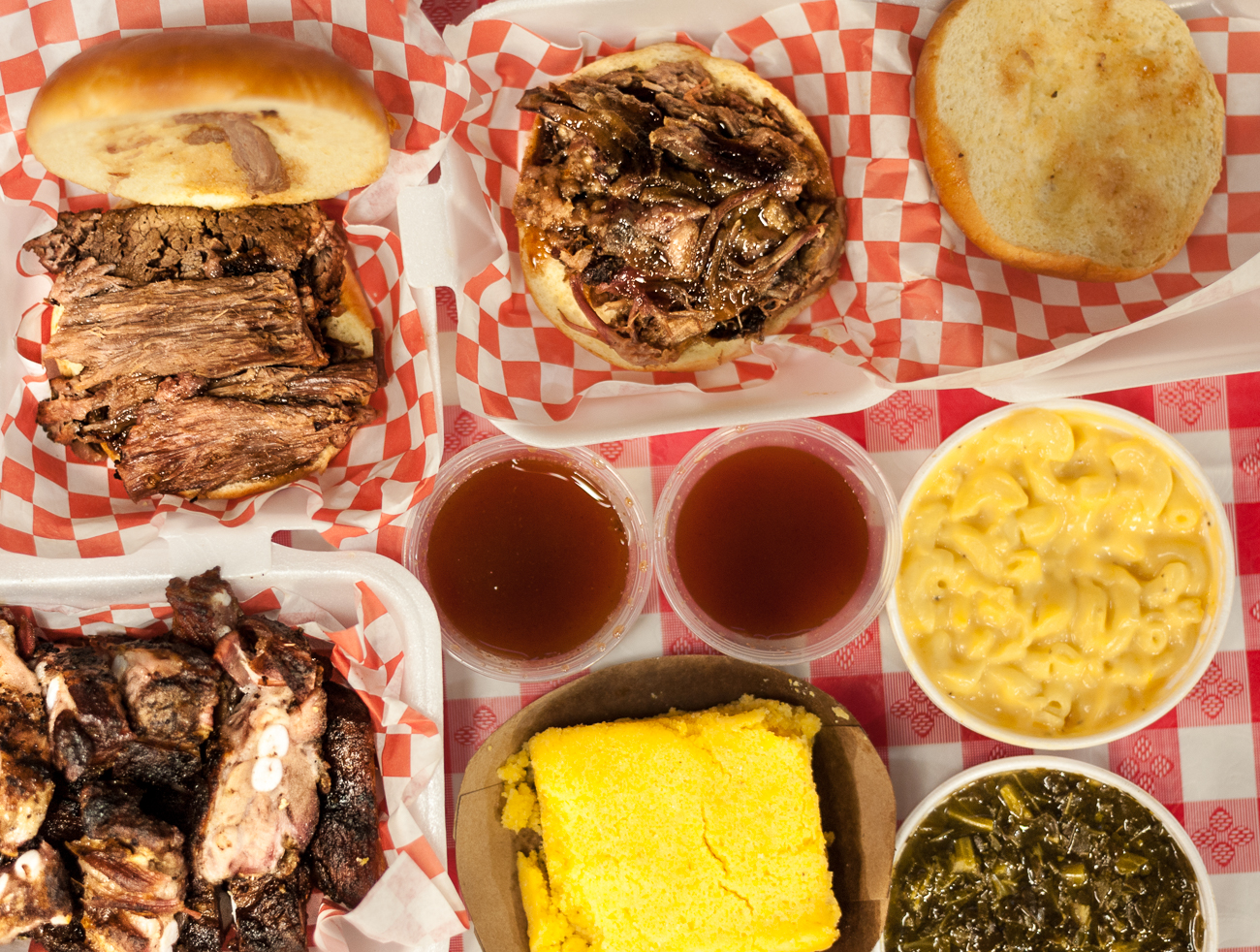 Rib tips, full brisket sandwich, pulled pork sandwich, mac & cheese, collard greens, and corn bread / Image: Kellie Coleman // Published: 6.19.20