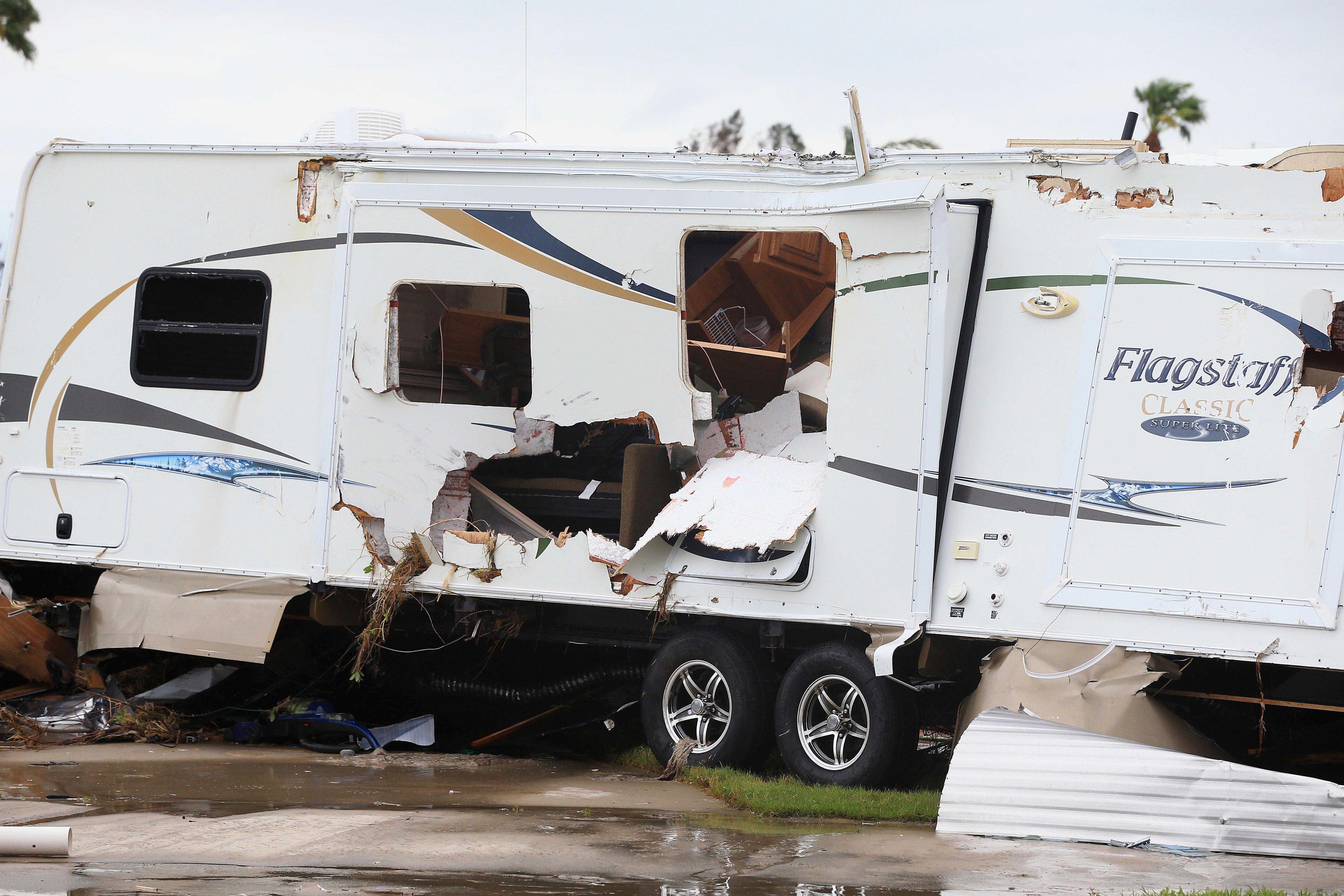 Mobile homes are destroyed at an RV park after Hurricane Harvey landed in the Coast Bend area on Saturday, Aug. 26, 2017, in Port Aransas, Texas. The National Hurricane Center has downgraded Harvey from a Category 1 hurricane to a tropical storm. Harvey came ashore Friday along the Texas Gulf Coast as a Category 4 storm with 130 mph winds, the most powerful hurricane to hit the U.S. in more than a decade. (Gabe Hernandez/Corpus Christi Caller-Times via AP)
