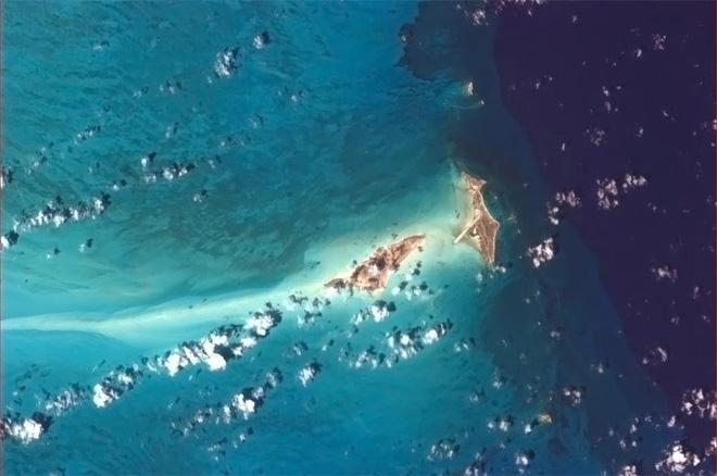 Big and Little Ambergris Cay, on the blue edge of the abyss. (Photo & Caption: Col. Chris Hadfield, NASA)