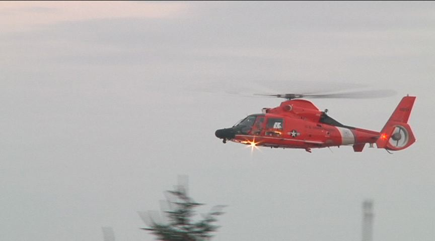 A Coast Guard helicopter searches Coos Bay on Wednesday. SBG photo