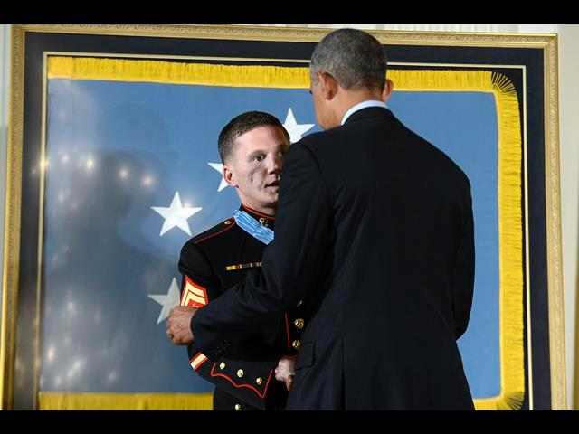 "President Barack Obama awards the Medal of Honor to retired Marine Cpl. William ""Kyle"" Carpenter during a ceremony at the White House in Washington, D.C., June 19, 2014."