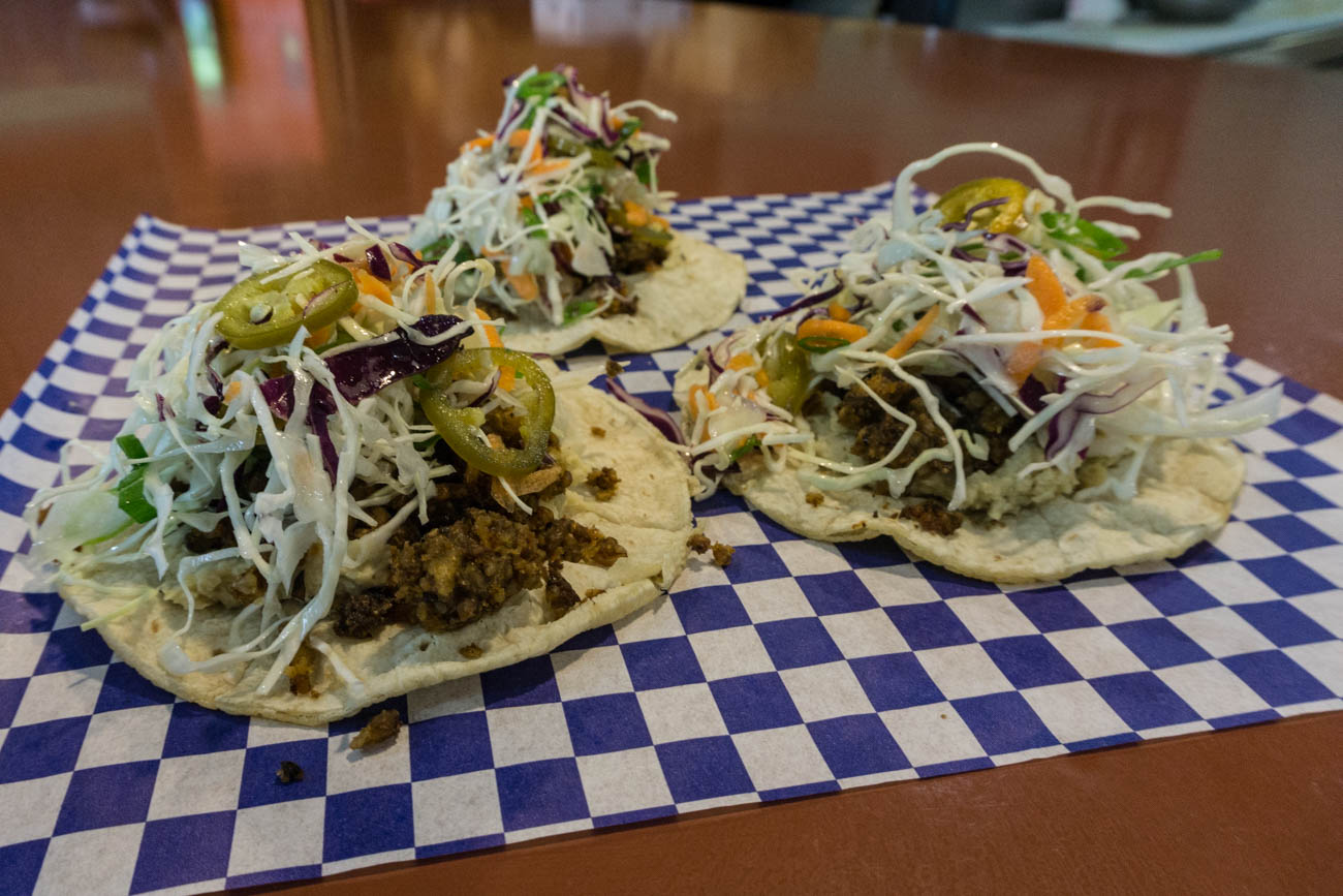 Namaste Tacos: meatless meat (made in house), Sister Mary Rosarita hummus, and jalapeño slaw, on corn tortillas / Image: Sarah Vester // Published: 8.7.17