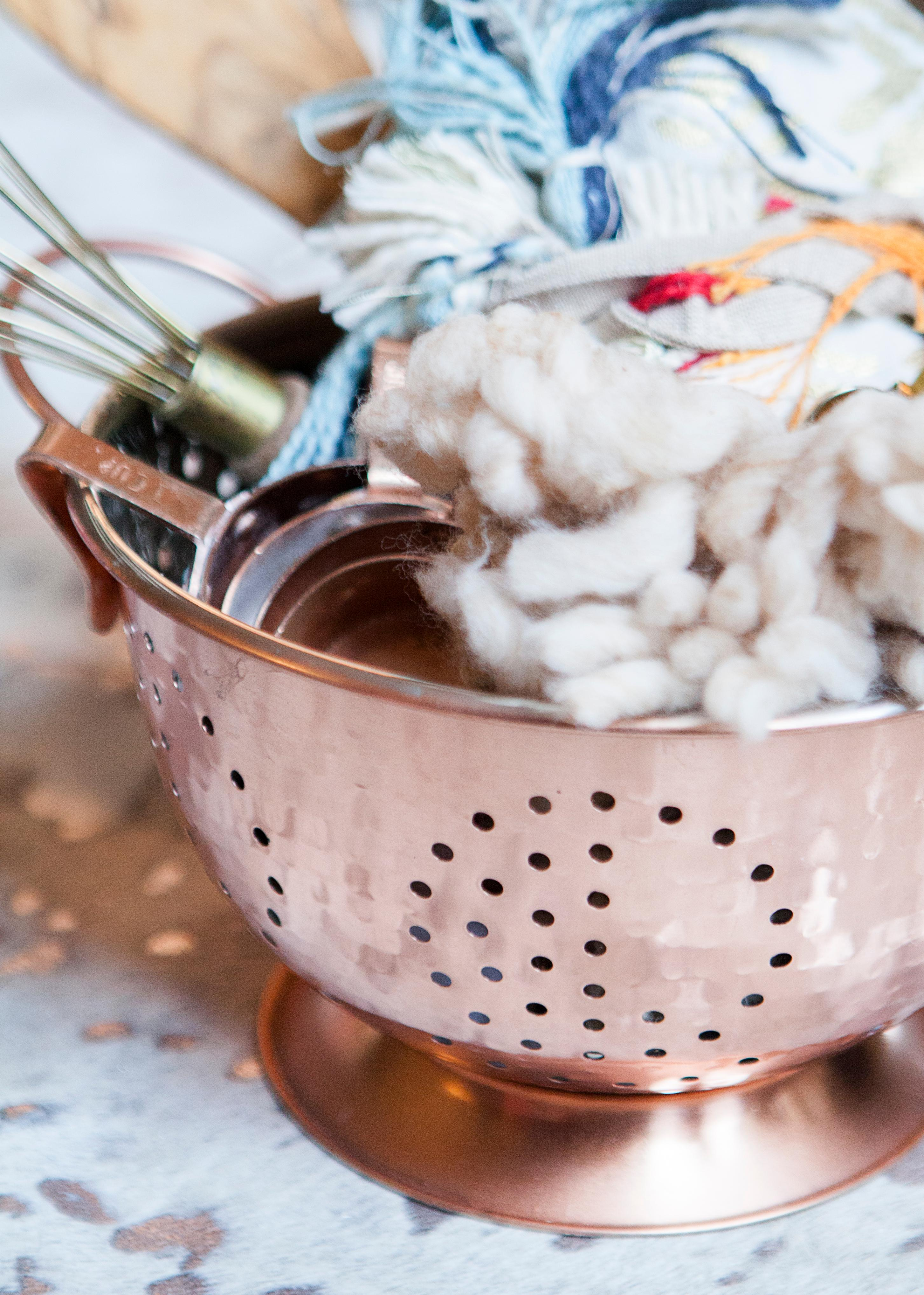 Stuff kitchen gifts in a colander or mixing bowl. (Image: Ashley Hafstead)