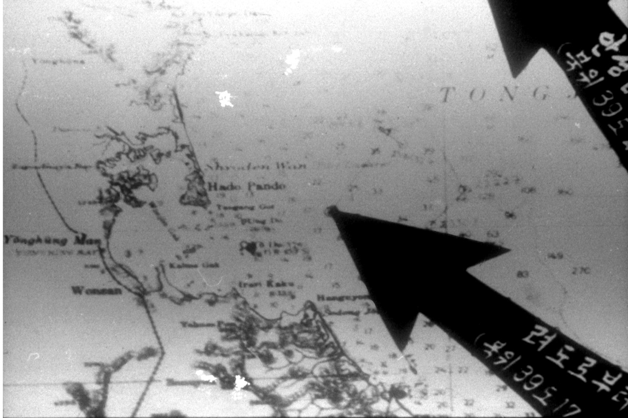 Poor-quality photograph of a chart of the Wonsan area, North Korea. The chart was exhibited by the North Korean government to support their claim that USS Pueblo (AGER-2) had entered that state's territorial waters off Wonsan before she was attacked and captured by North Korean forces on 23 January 1968. U.S. Naval History and Heritage Command Photograph.