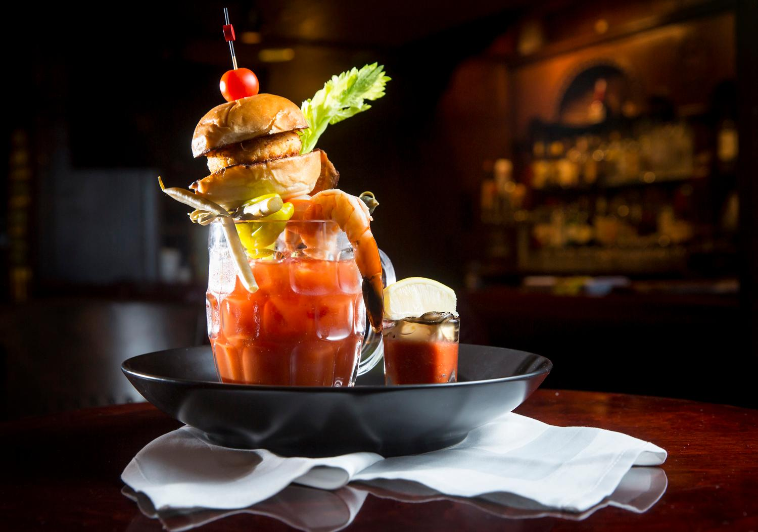 The 12th Fan Bloody Mary includes 12 specialty ingredients including a crab-cake slider, tiger prawn, and oyster shooter, which is featured on Shuckers' game day brunch menu. You can find this beauty at the Fairmont Olympic Hotel at 411 University St, Seattle, WA 98101. (Sy Bean / Seattle Refined)