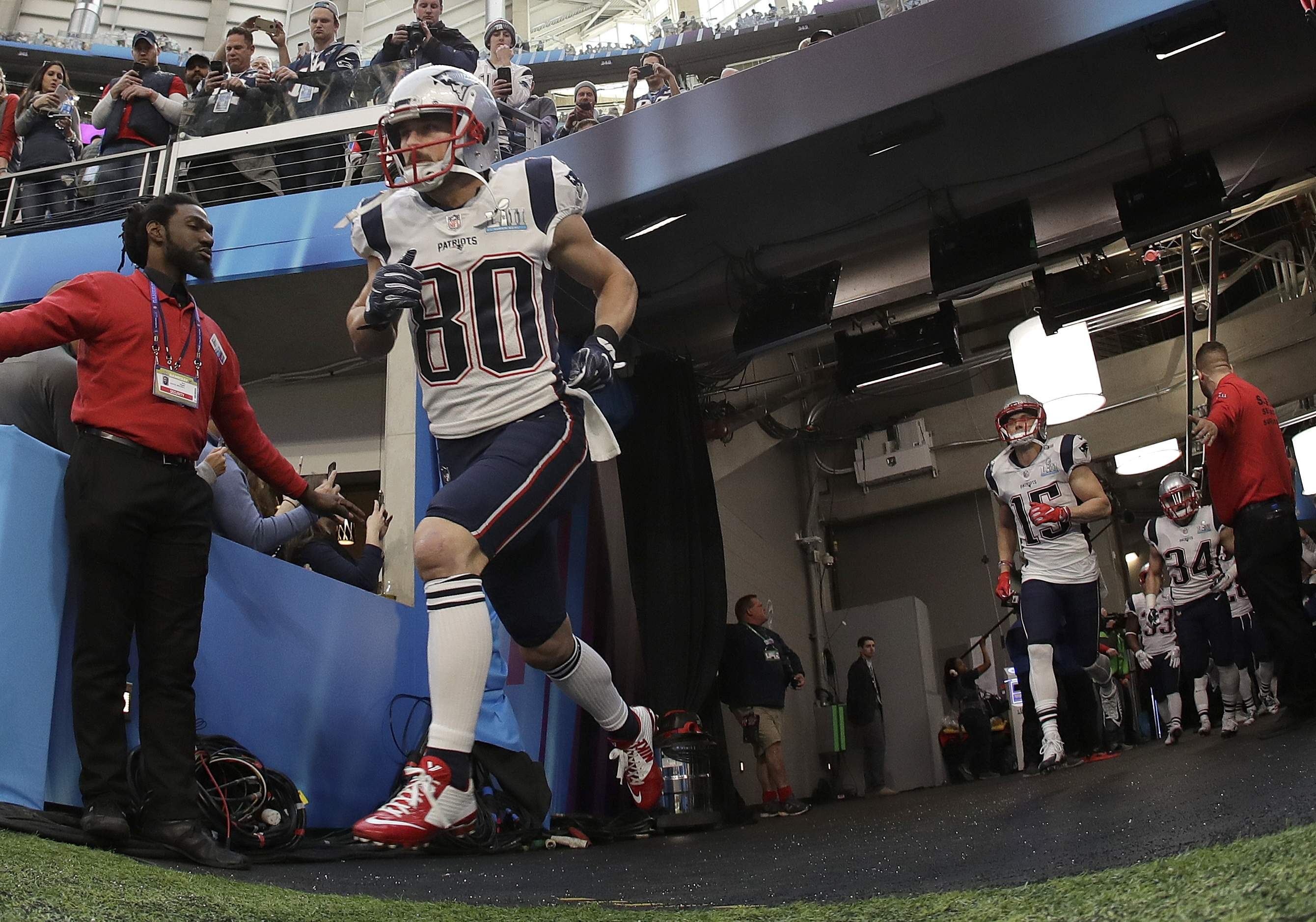 New England Patriots' Danny Amendola runs out of the tunnel before the NFL Super Bowl 52 football game against the Philadelphia Eagles Sunday, Feb. 4, 2018, in Minneapolis. (AP Photo/Matt Slocum)