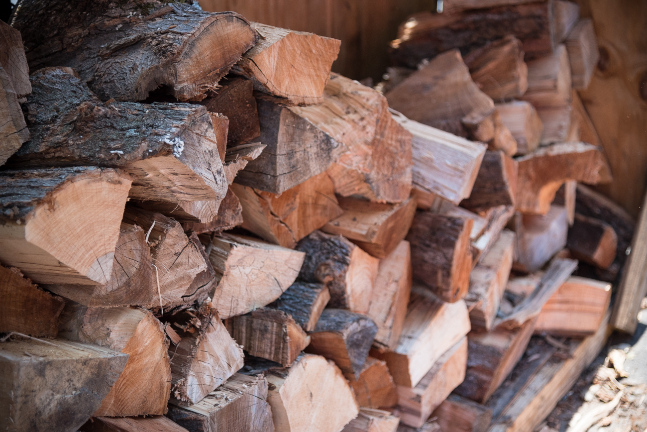 Piles of wood ready to fuel the outdoor smoker when needed / Image: Phil Armstrong, Cincinnati Refined