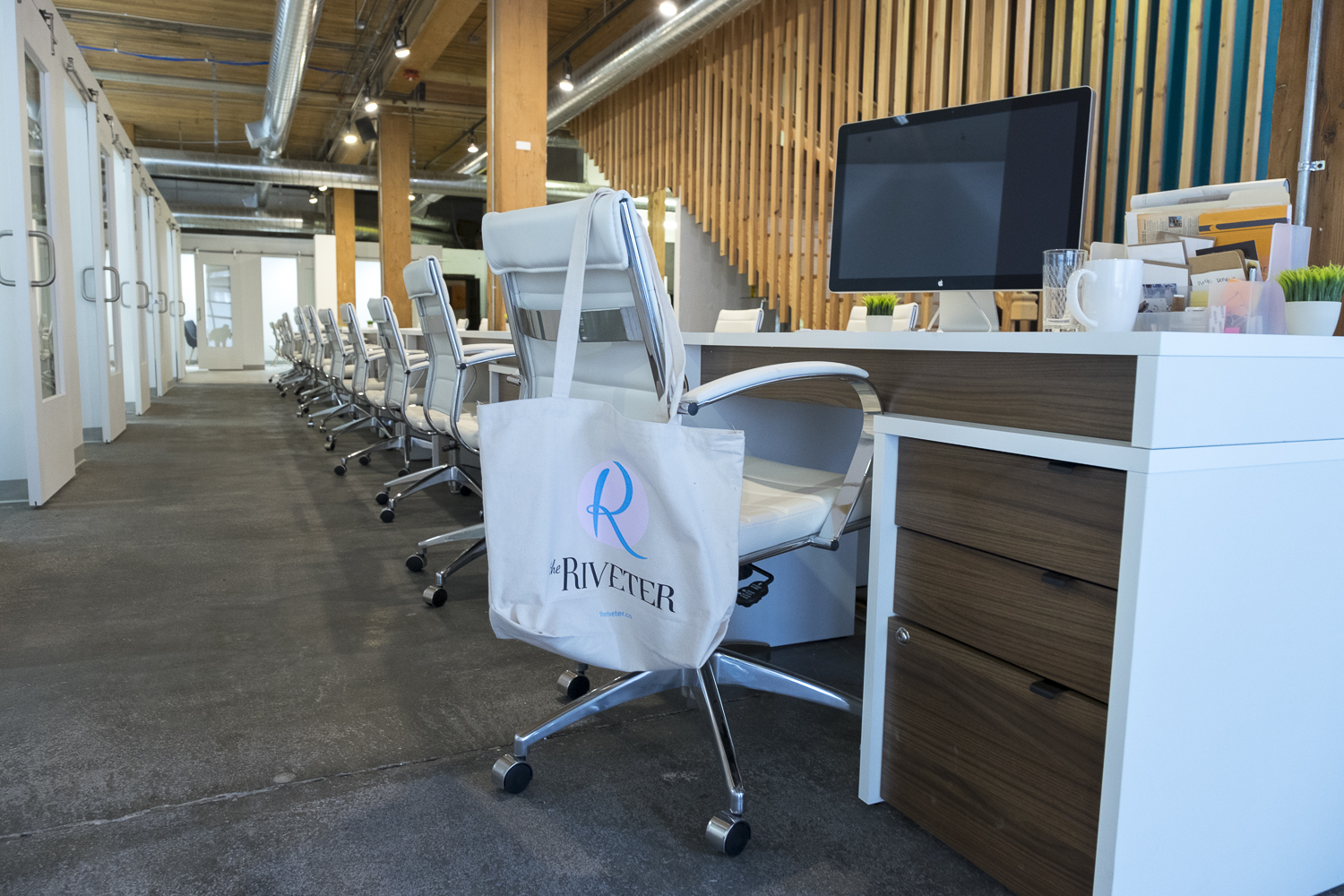 Permanent desks at The Riveter (Image: Paola Thomas/Seattle Refined)
