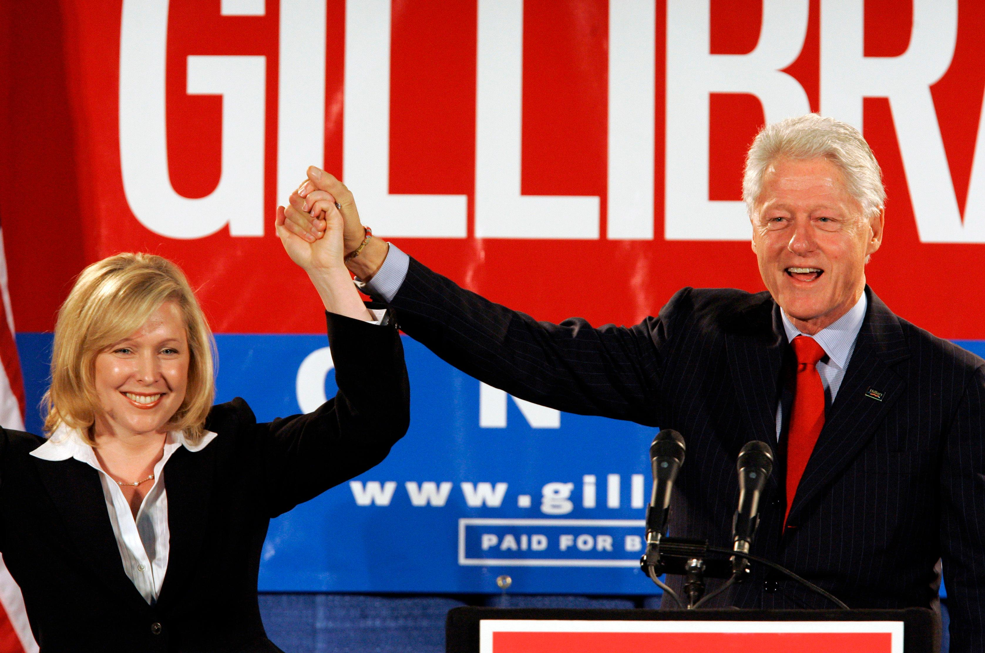FILE- In this Oct. 26, 2006 file photo, former President Bill Clinton holds up the hand of Kirsten Gillibrand, a Democratic lawyer who is running against three-term Rep. John Sweeney, R-N.Y., at a rally in Albany, N.Y.{&amp;nbsp;} (AP Photo/Jim McKnight, File)<p></p>