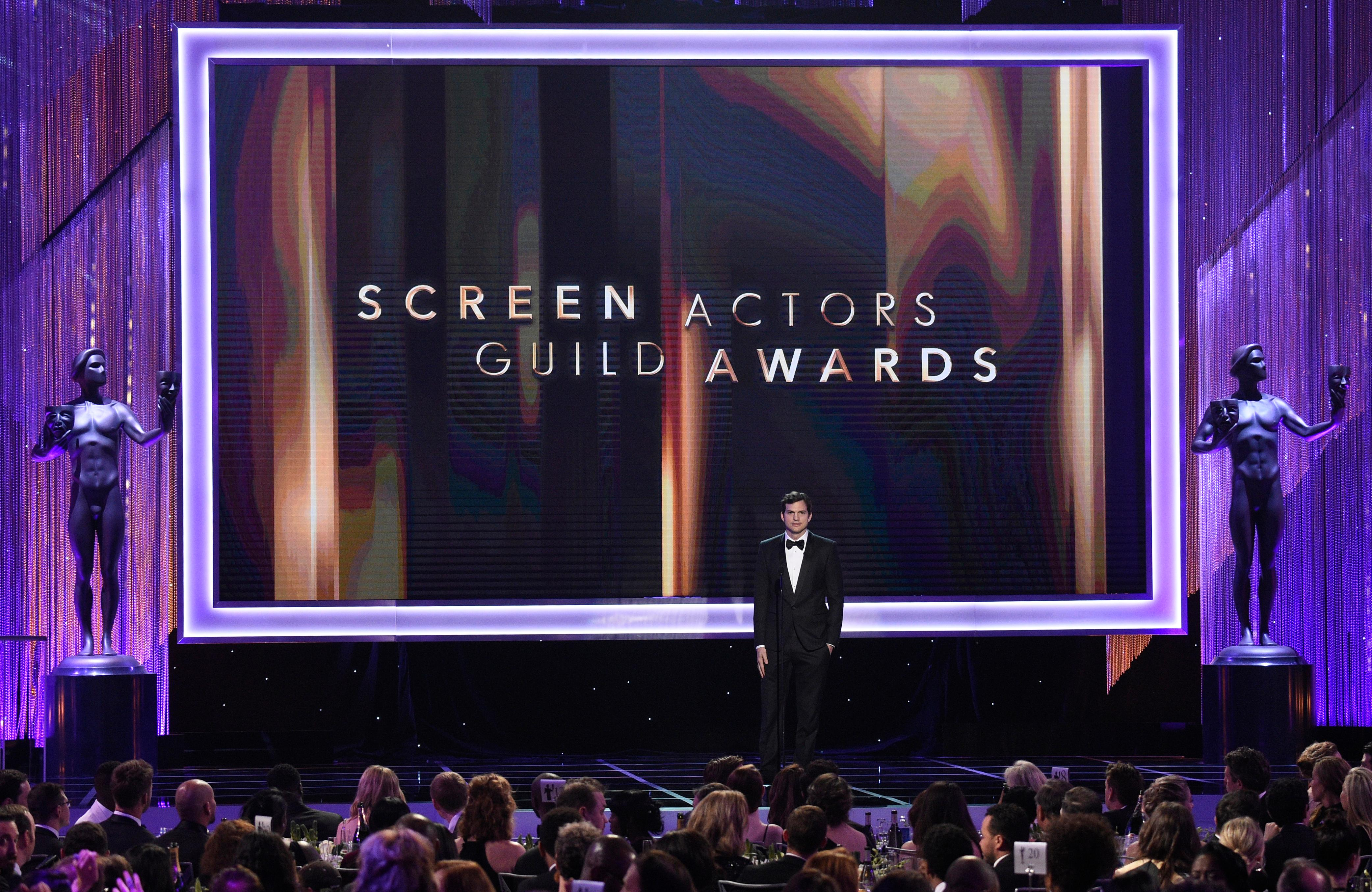 FILE - In this Jan. 29, 2017 file photo, Ashton Kutcher presents the award for outstanding performance by a female actor in a comedy series at the 23rd annual Screen Actors Guild Awards in Los Angeles. The 2018 SAG Awards nominations for achievements in film and television will be announced on Wednesday, Dec. 13.  (Photo by Chris Pizzello/Invision/AP, File)