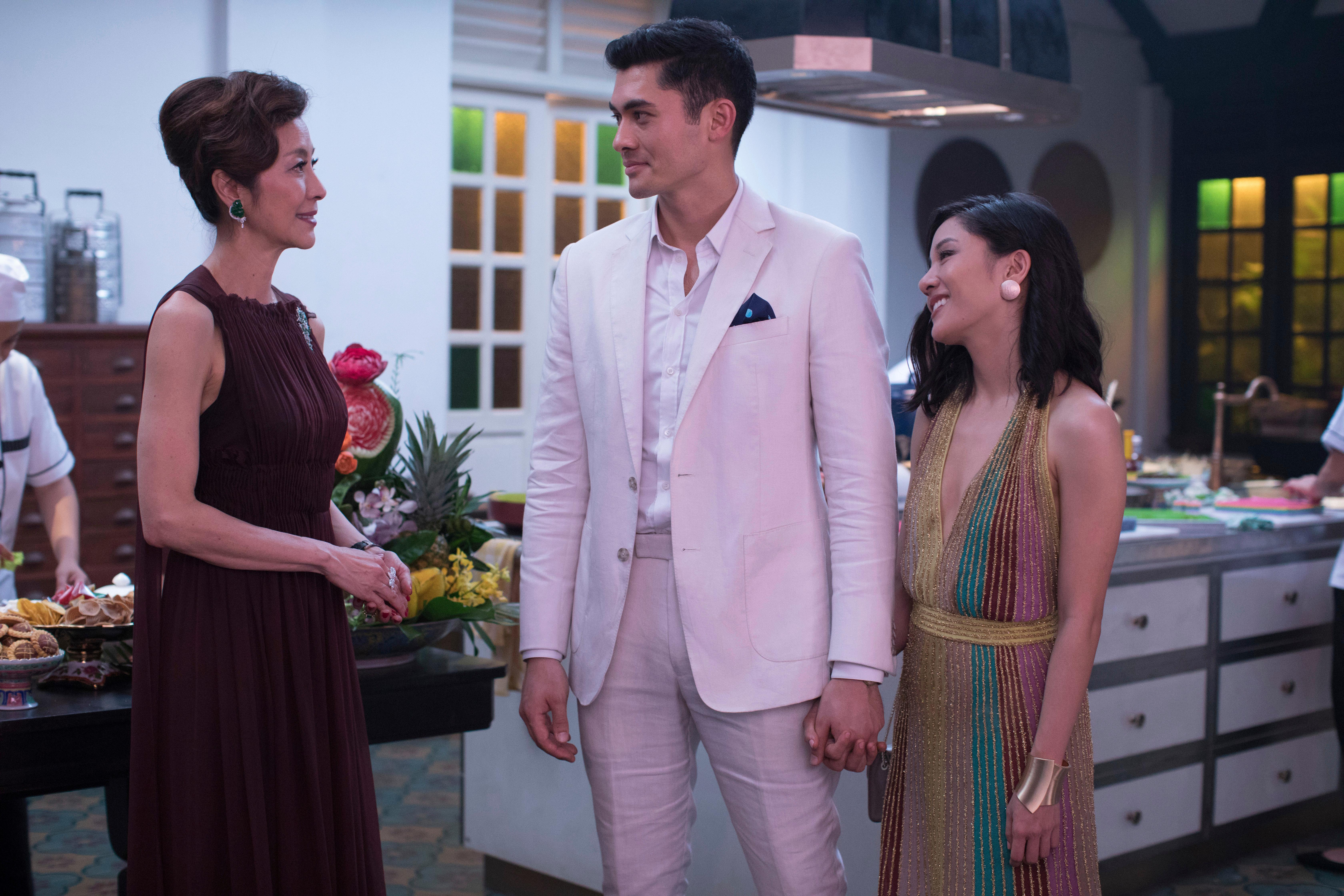 "This image released by Warner Bros. Entertainment shows Michelle Yeoh, from left, Henry Golding and Constance Wu in a scene from the film ""Crazy Rich Asians.""{ } (Sanja Bucko/Warner Bros. Entertainment via AP)"