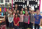 Michelle Loewenhagen and her second grade class pose with her Golden Apple Award Feb. 7, 2018, at Valley View Elementary School in Ashwaubenon.