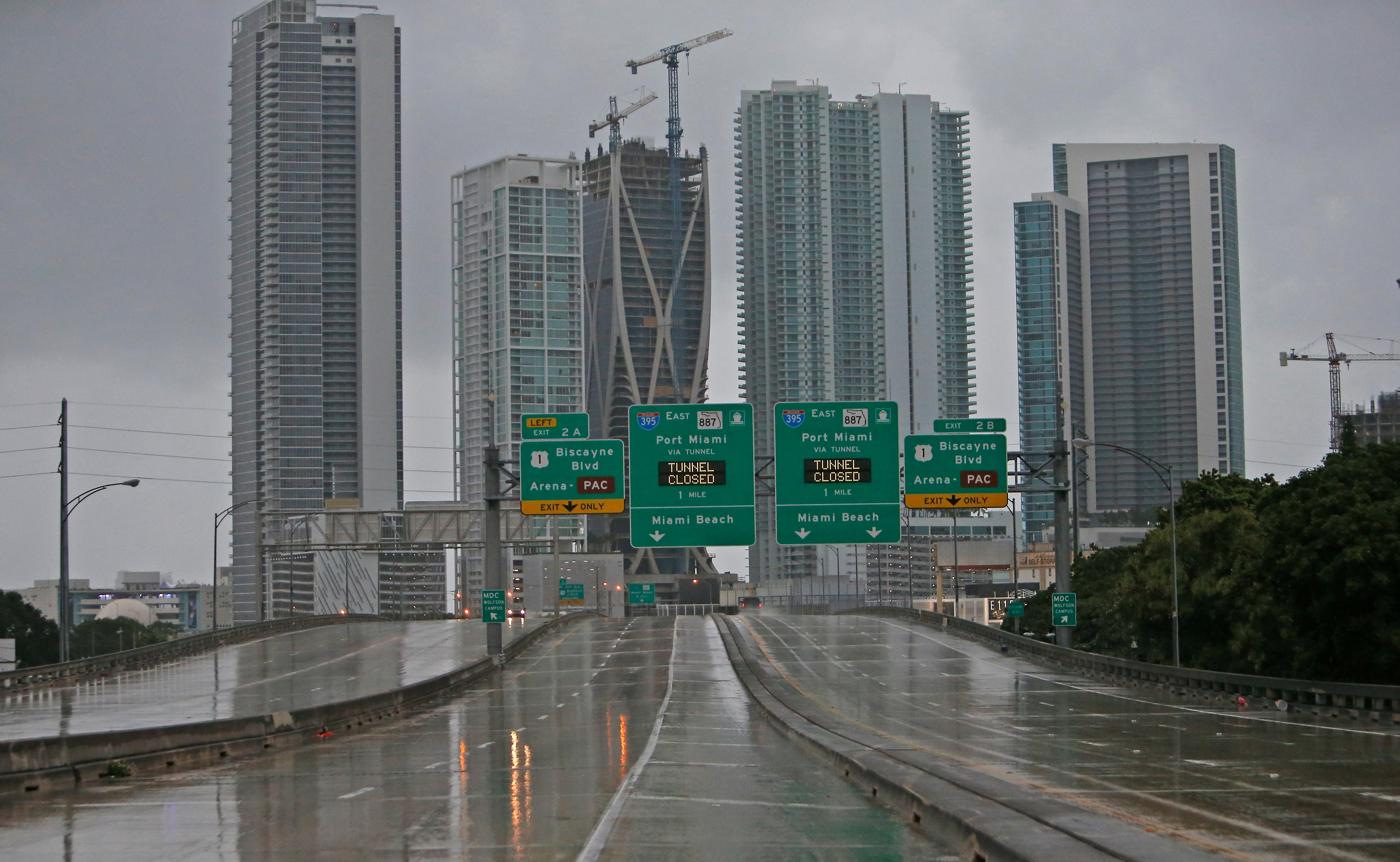 The Interstate remains empty as the outer bands of Hurricane Irma reached South Florida early Saturday, Sept.  9, 2017 in Miami. Gov. Rick Scott is urging anyone living in an evacuation zone in southwest Florida to leave by noon as the threat of Hurricane Irma has shifted west.  (David Santiago/Miami Herald via AP)