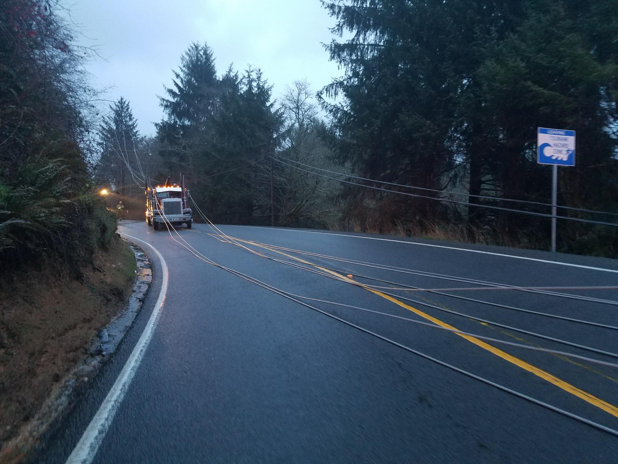 A fatal cash brought live powerlines down across Highway 101 between Lincoln City and Tillamook on Thursday morning, closing the coast highway, Oregon State Police said. (OSP)