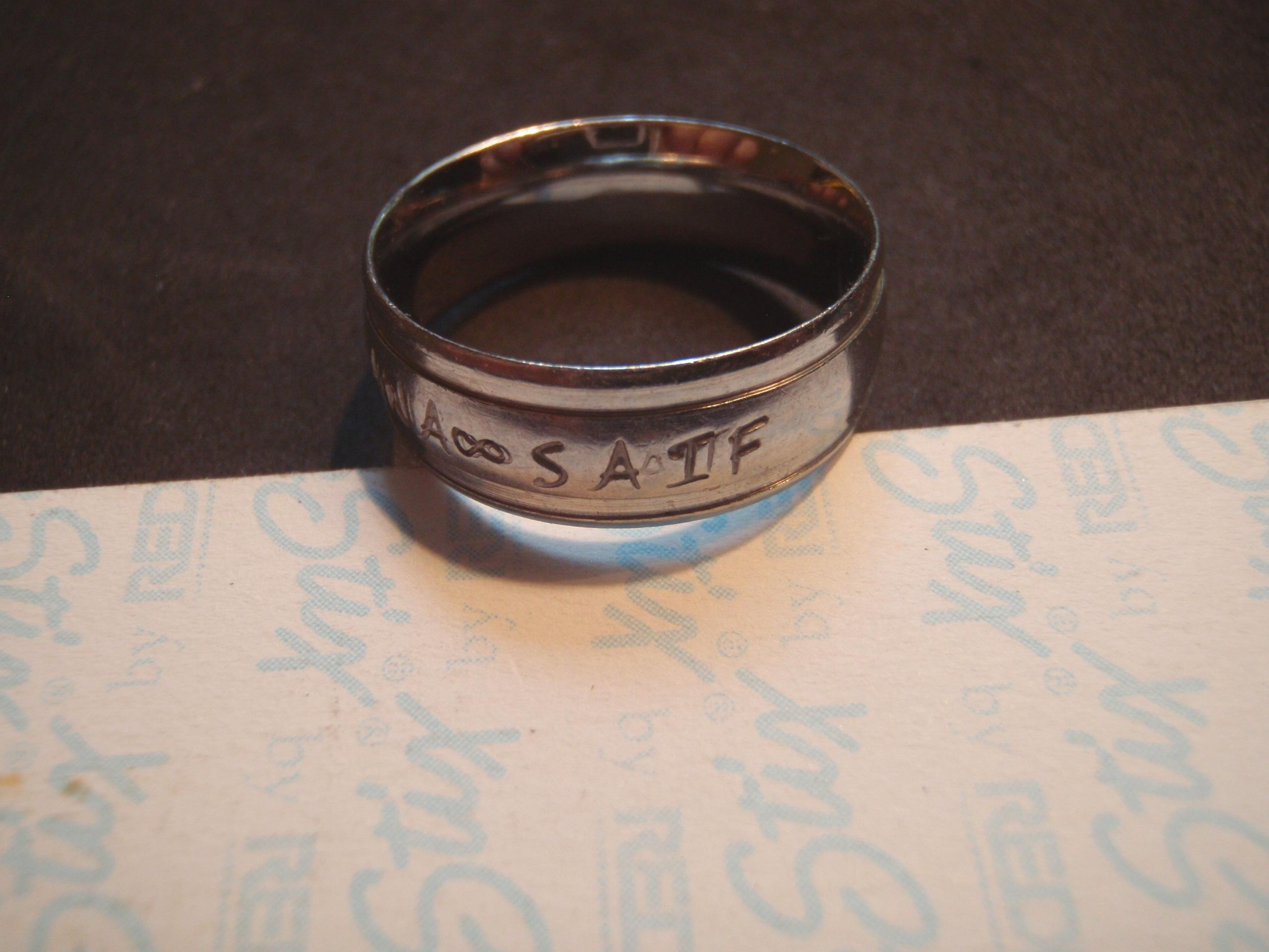 "Lou Christen says he was diving in the Saco River recently and found a ring with the inscription ""Rana – Saif"" and the date ""8-16-15"" on it. (Courtesy: Lou Christen)"