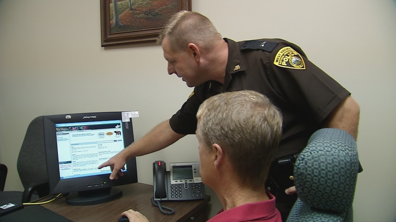 Lieutenant Ed Goodson, a West Virginia Natural Resources police officer, demonstrates how easy it is to sign up for a Hunter's Education course. (WCHS/WVAH)<p></p>
