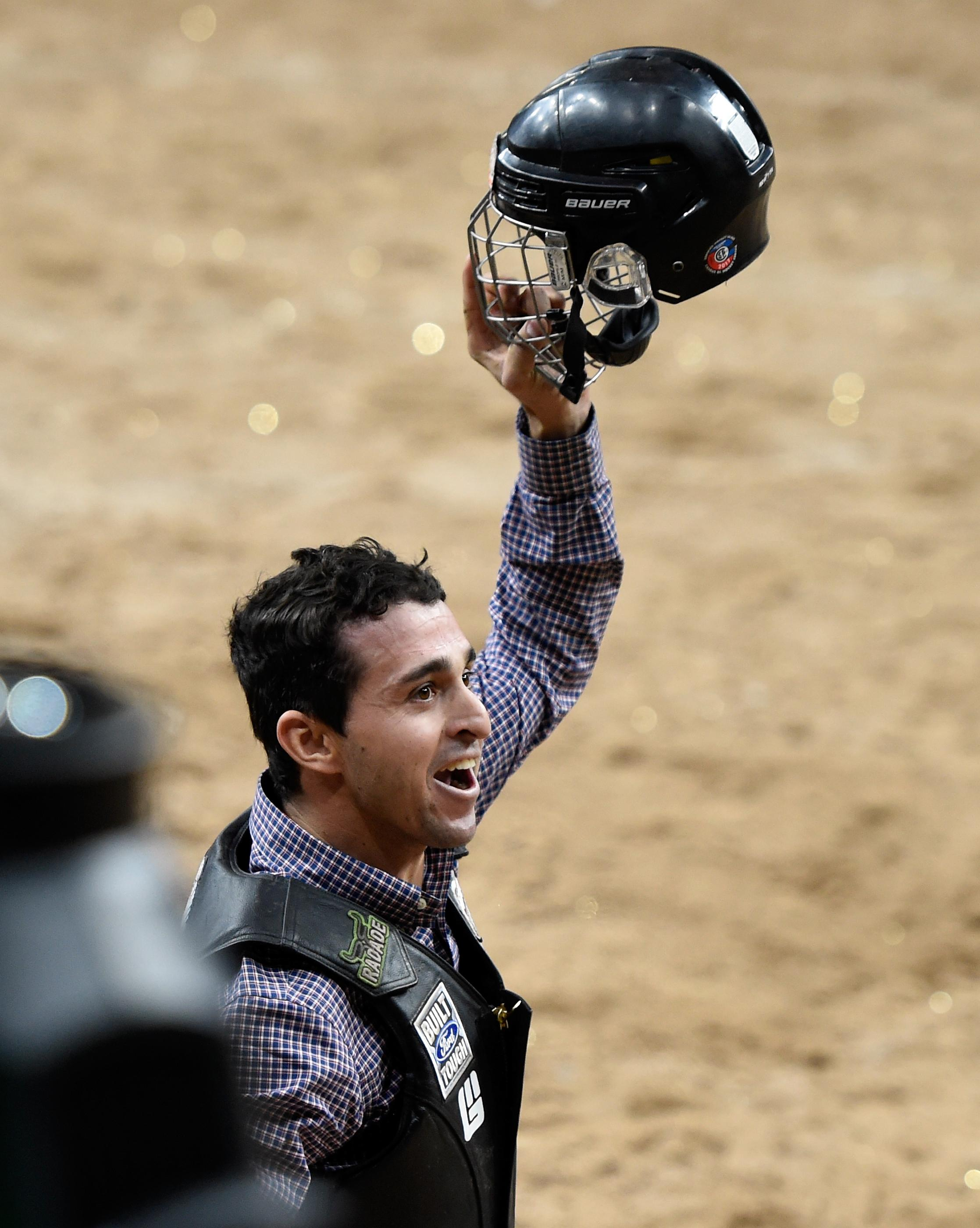 Claudio Montanha Jr. reacts after his ride during the PBR World Finals at T-Mobile Arena Sunday, Nov. 5, 2017, in Las Vegas. [David Becker/Las Vegas News Bureau]