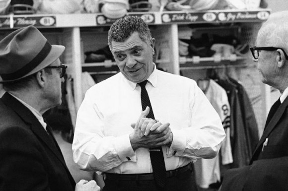 "Green Bay Packers coach Vince Lombardi explains Dec. 28, 1967, how the Lambeau Field ""electric blanket"" is keeping the playing surface soft for the NFL Championship Game three days later. Buried electric heating cables were to provide the heat. However, the heating system failed on game day. (AP Photo/Paul Shane)"