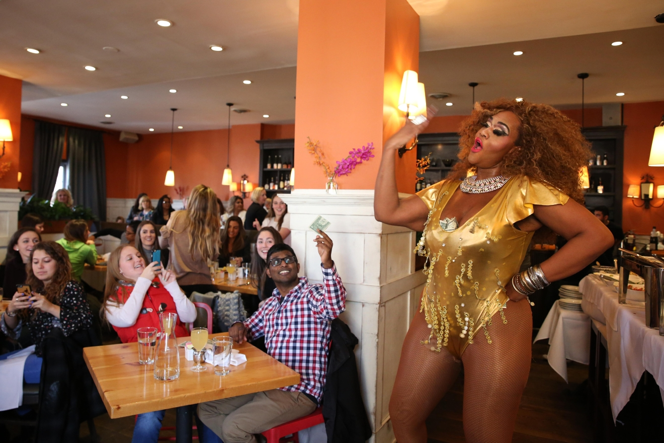 Perry's Restaurant hosts D.C.'s longest-running drag brunch. Although the queens offer up sharp-witted jokes definitely suited for an adult crowd, the talent is staggering and earns wild cheers from patrons waving around dollar bills. (Amanda Andrade-Rhoades/DC Refined)