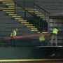 Workers start pulling up boards from East Grandstands at Hayward Field
