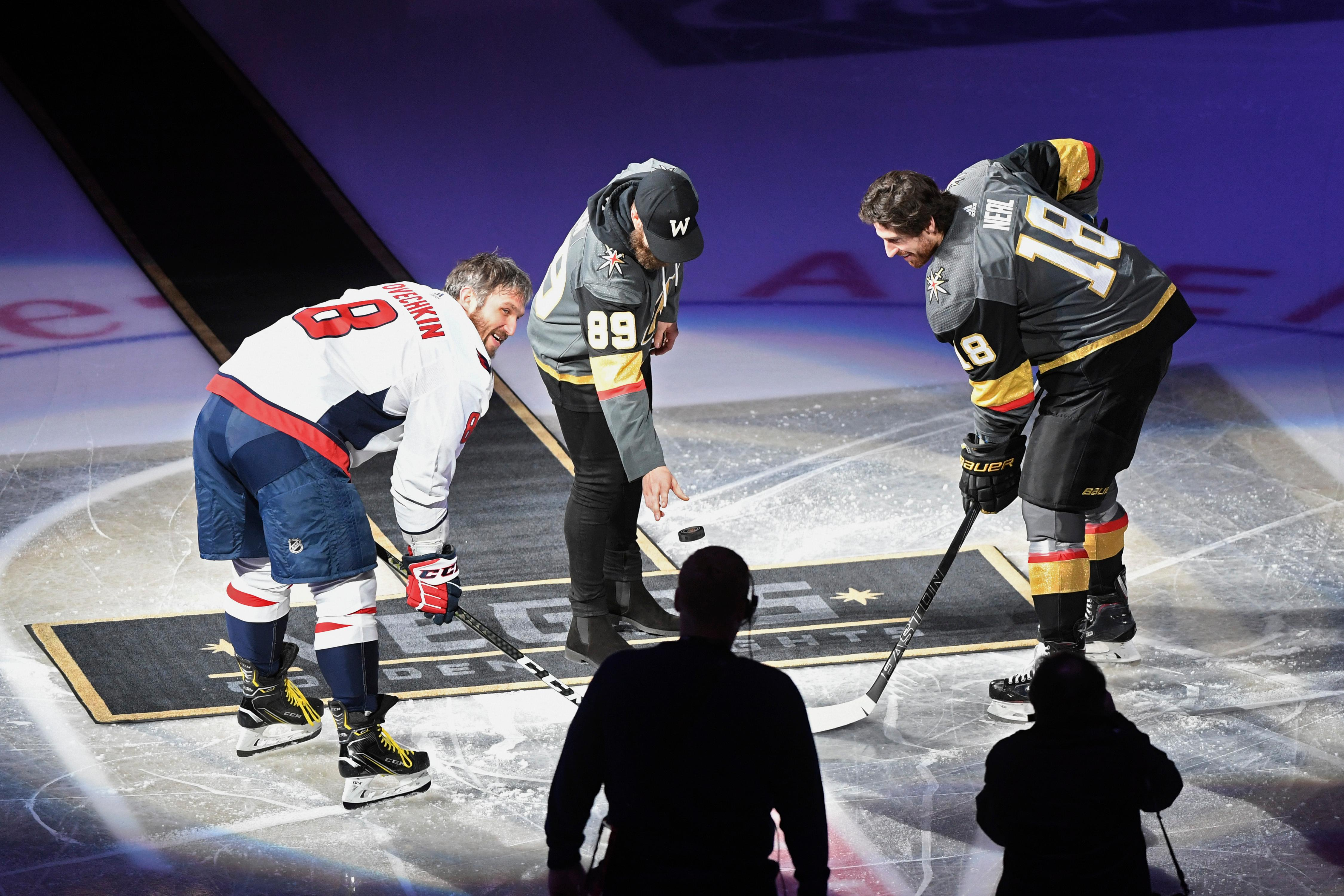 Washington Nationals pitcher and Las Vegas native Bryce Harper drops the ceremonial first puck as Washington Capitals left wing Alex Ovechkin (8) and Vegas Golden Knights left wing James Neal (18) watch before their NHL hockey game Saturday, December 23, 2017, at T-Mobile Arena in Las Vegas.  CREDIT: Sam Morris/Las Vegas News Bureau