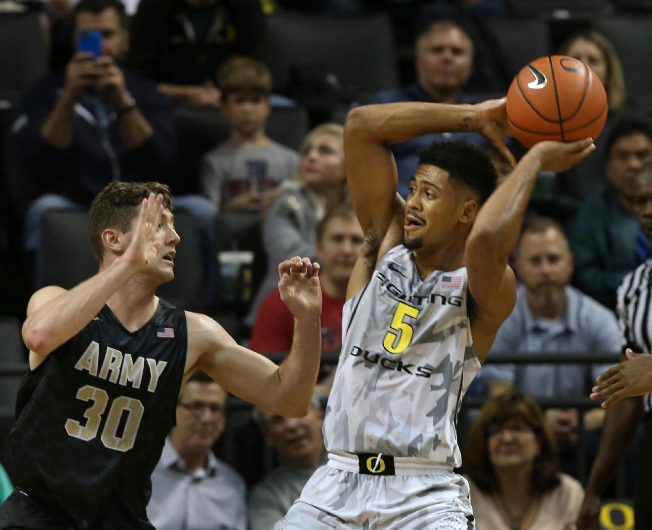 Army's Jordan Fox, left, guards Oregon's Tyler Dorsey during the second half of an NCAA college basketball game Friday, Nov. 11, 2016, in Eugene, Ore. Oregon won 91-77.  (AP Photo/Chris Pietsch)