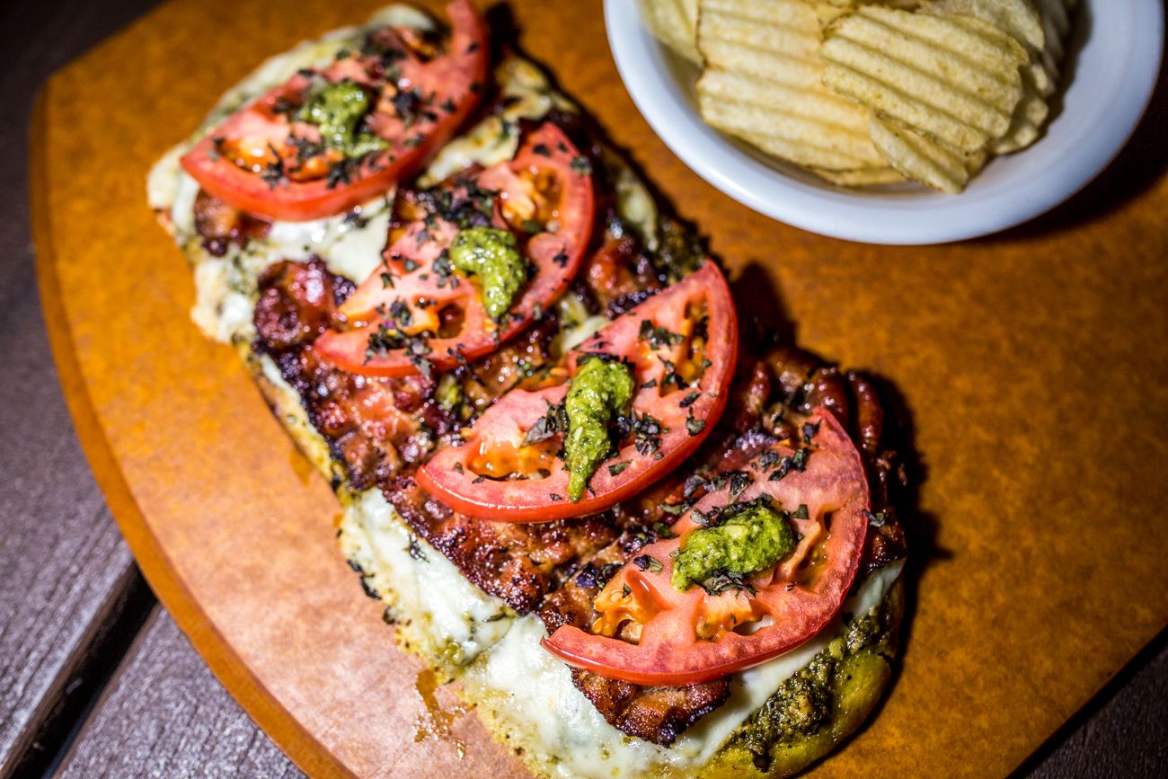 Twisted BLT: tandori naan flat bread topped with pesto, bacon, tomatoes, and topped with a dash of basil / Image: Catherine Viox{ }// Published: 9.1.19