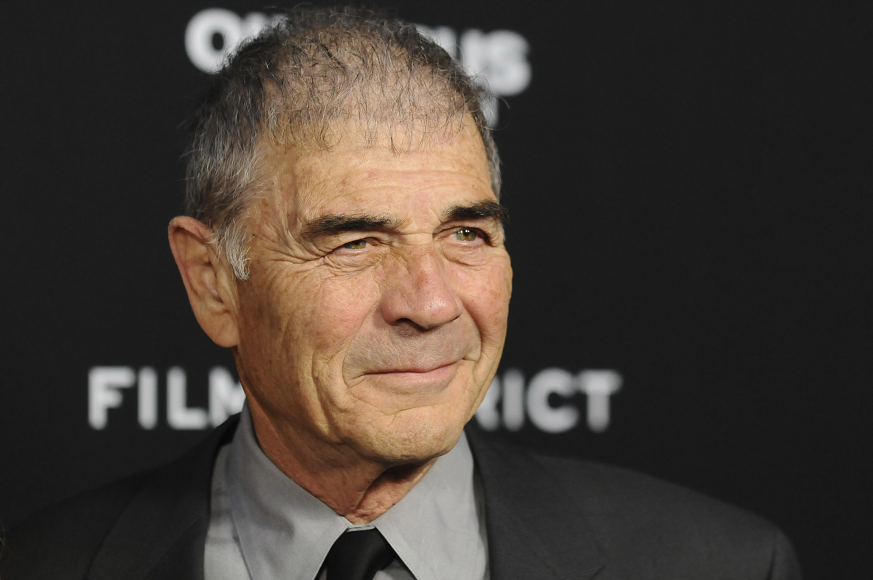 "FILE - In this Monday, March 18, 2013 file photo, Robert Forster arrives at the LA premiere of ""Olympus Has Fallen"" at the ArcLight Theatre in Los Angeles. Forster, the handsome character actor who got a career resurgence and Oscar-nomination for playing bail bondsman Max Cherry in ""Jackie Brown,"" has died at age 78. Forster's agent Julia Buchwald says he died Friday, Oct. 11, 2019, at home in Los Angeles of brain cancer.  (Photo by Jordan Strauss/Invision/AP, File)"