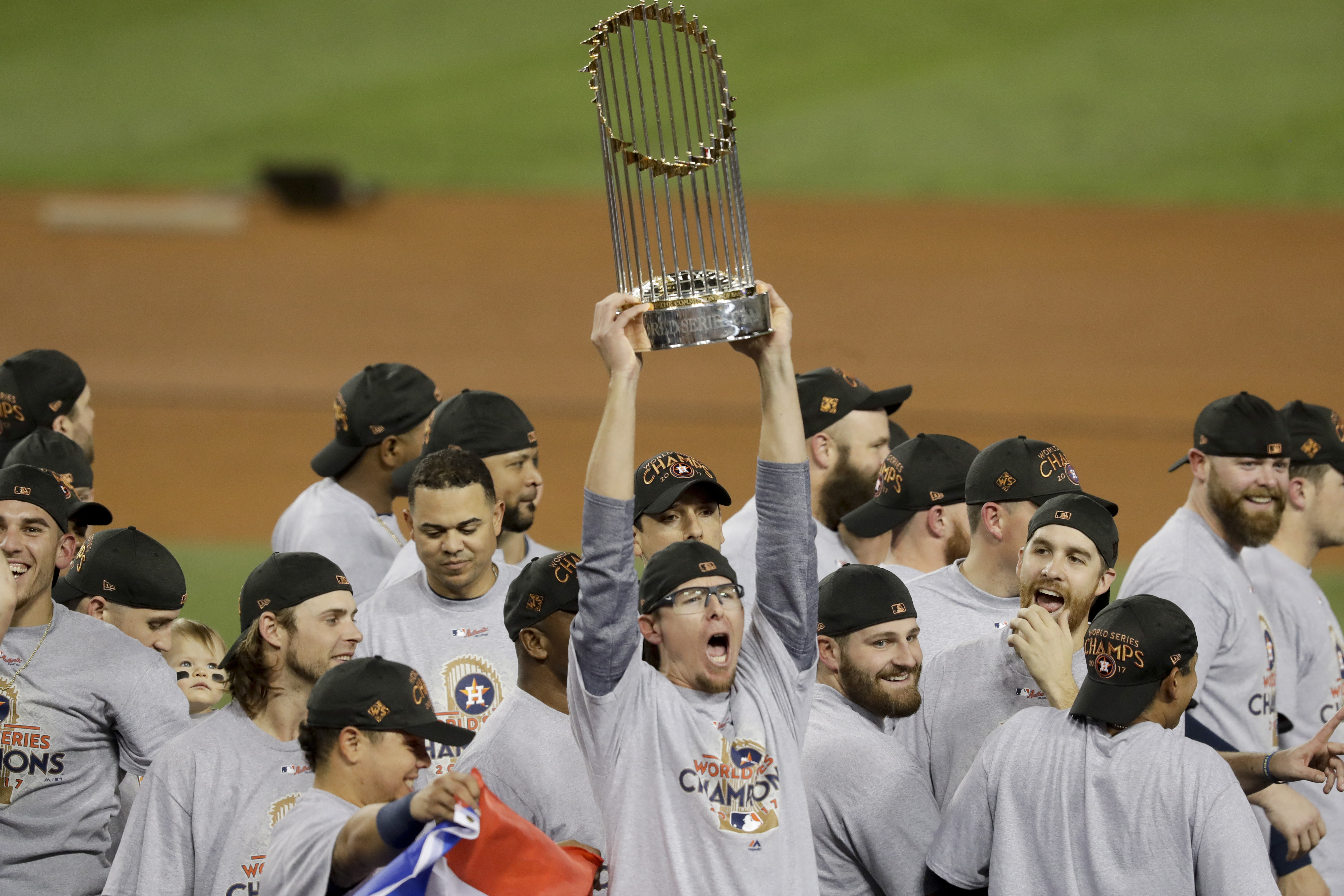 The Houston Astros celebrate with the trophy after their win against the Los Angeles Dodgers in Game 7 of the World Series Wednesday, Nov. 1, 2017, in Los Angeles. The Astros won 5-1 to win the series 4-3. (AP Photo/Alex Gallardo)