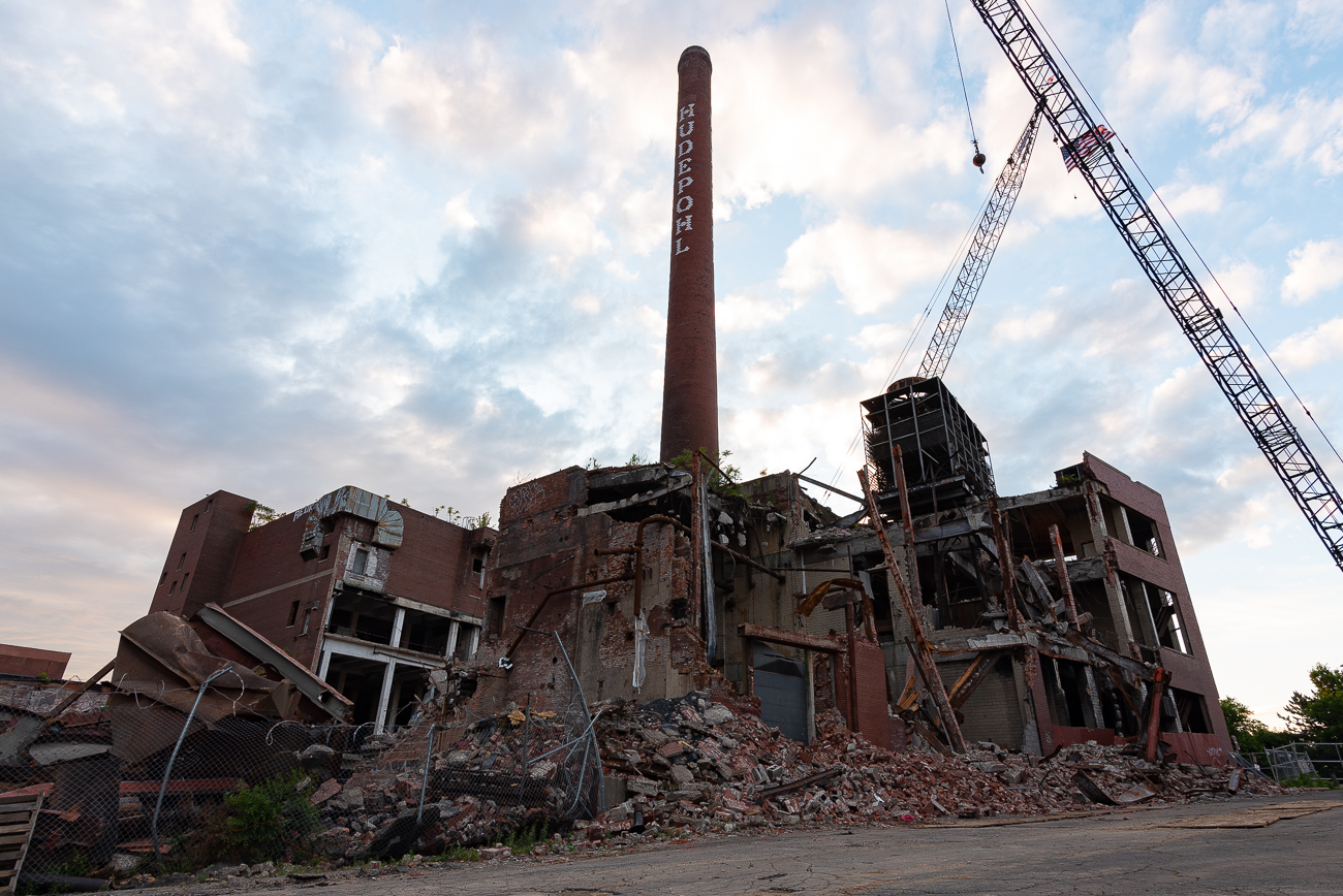 Since 1988, the Hudepohl Brewery in Queensgate, easily recognizable due to its iconic smokestack, has been closed. After years of remaining empty, it's finally being demolished. There is no current plan for the site at the time of this writing. The structure is understood to have been built in the 19th century, and once housed a different brewery (Lackman) before eventually becoming Hudepohl. While pieces of the building were salvaged to reappropriate for tours along the Brewing Heritage Trail, Hudepohl's smokestack is planned for demolition this weekend. Here's a final look at it before it's gone forever. / Image: Phil Armstrong // Published: 6.14.19
