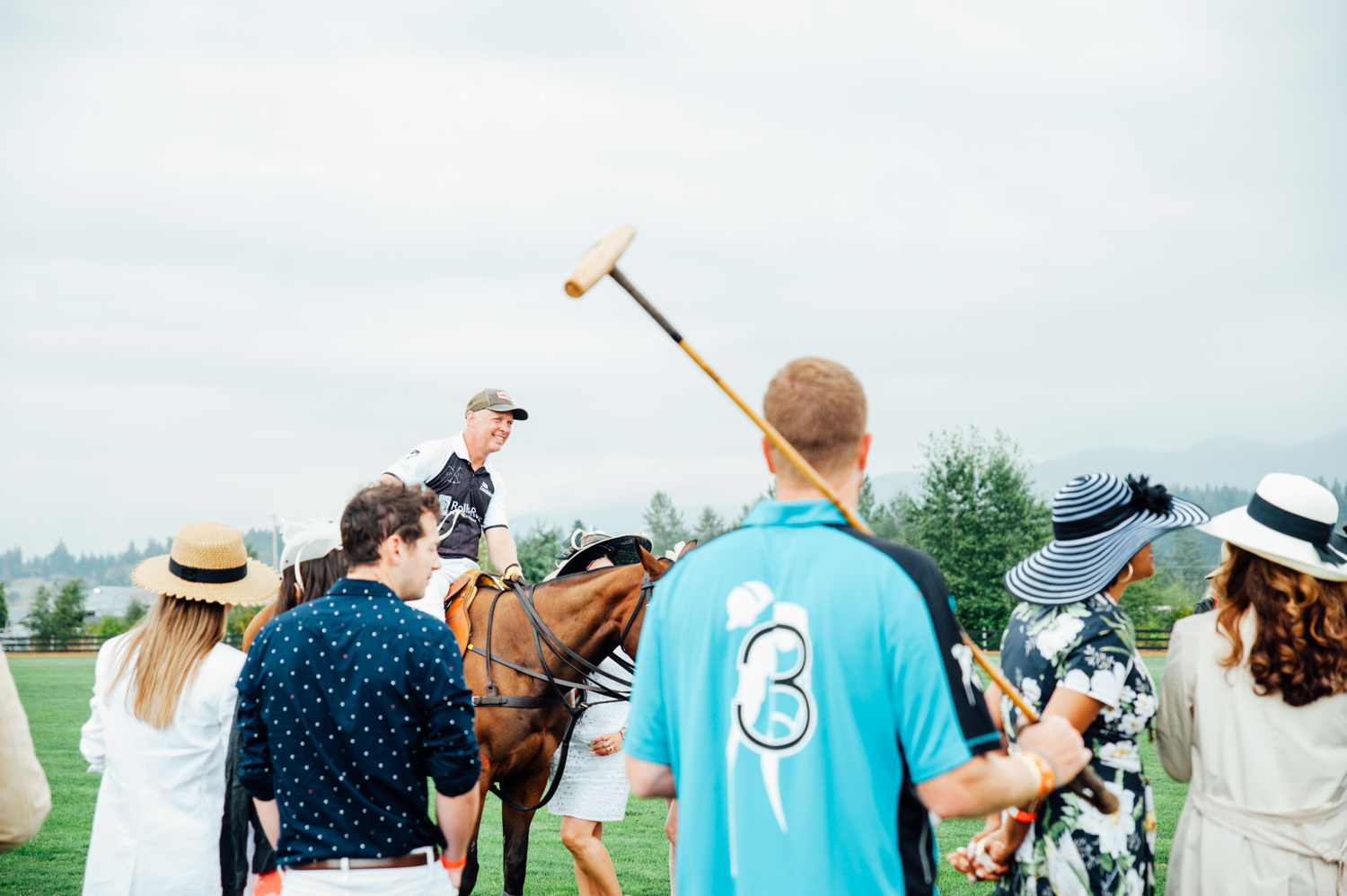 Yes, such a thing exists! Every year the Seattle Polo & Equestrian Club puts on quit a show inn Enumclaw, where attendees are dressed to impress in the Fashion Parade, watching multiple polo games, team processionals, woman's hat parade and of course - the divot stomp. (Image: Elizabeth Crook / Seattle Refined)