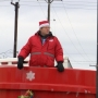 Man in red kettle reaches goal, gets to go home