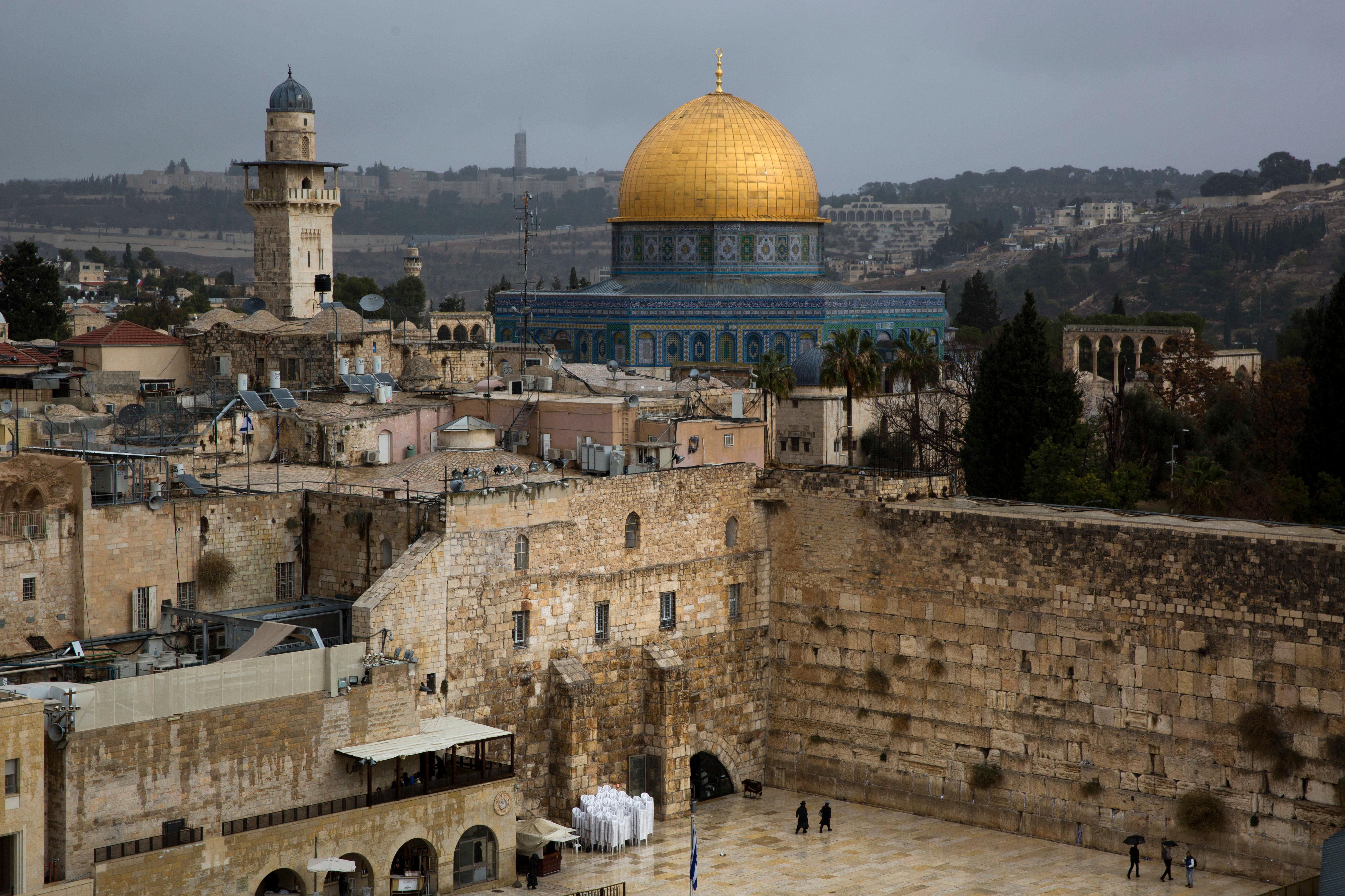 A view of the Western Wall and the Dome of the Rock, some of the holiest sites for for Jews and Muslims, is seen in Jerusalem's Old City, Wednesday, Dec. 6, 2017. U.S. officials say President Donald Trump will recognize Jerusalem as Israel's capital Wednesday, Dec. 6, and instruct the State Department to begin the multi-year process of moving the American embassy from Tel Aviv to the holy city. His decision could have deep repercussions across the region. (AP Photo/Oded Balilty)