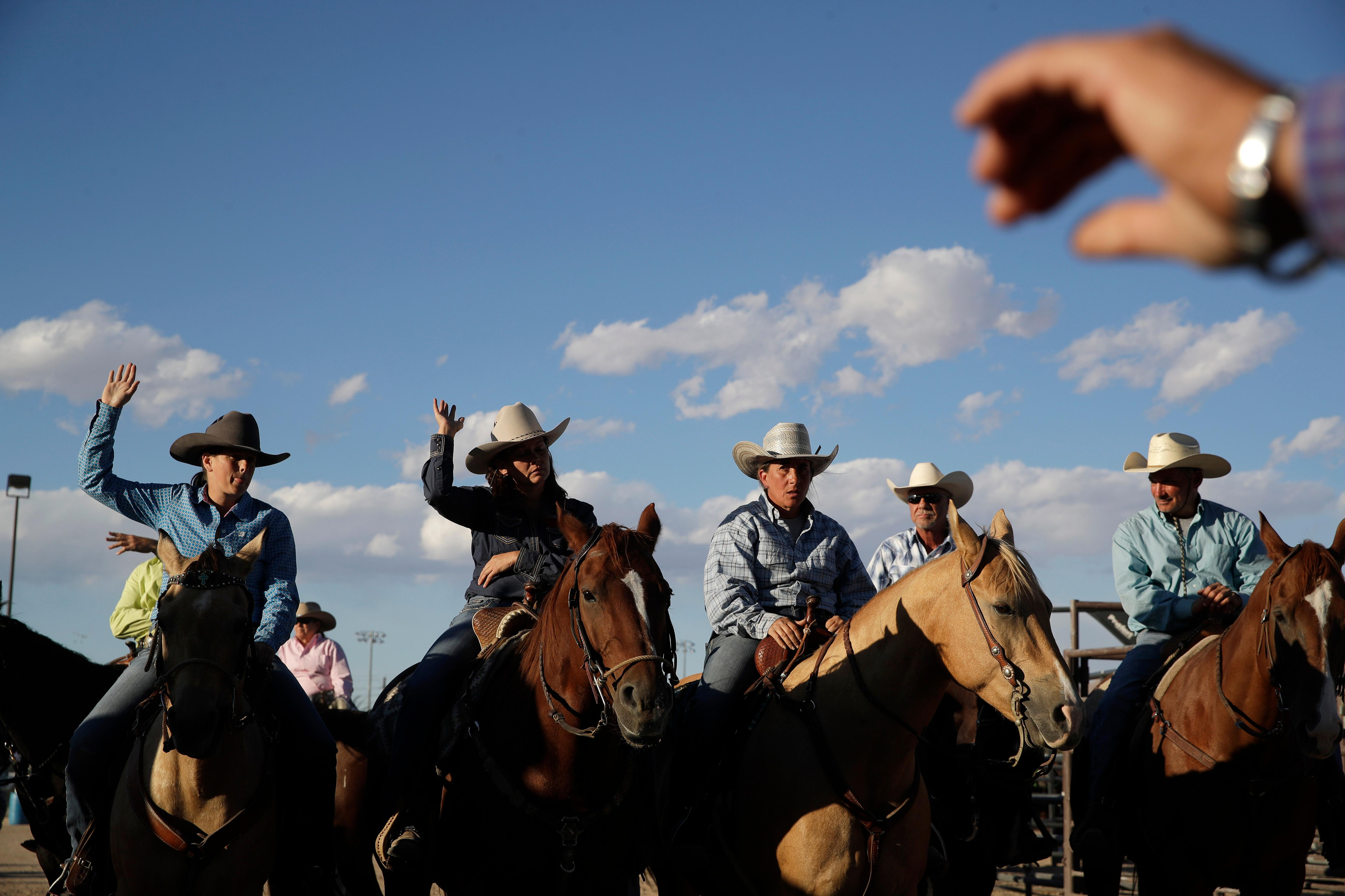 In this Sept. 23, 2017, photo, competitors prepare to compete in the barrel racing event at the Bighorn Rodeo in Las Vegas. Unlike traditional rodeos, both men and women can compete in any of the events. (AP Photo/John Locher)