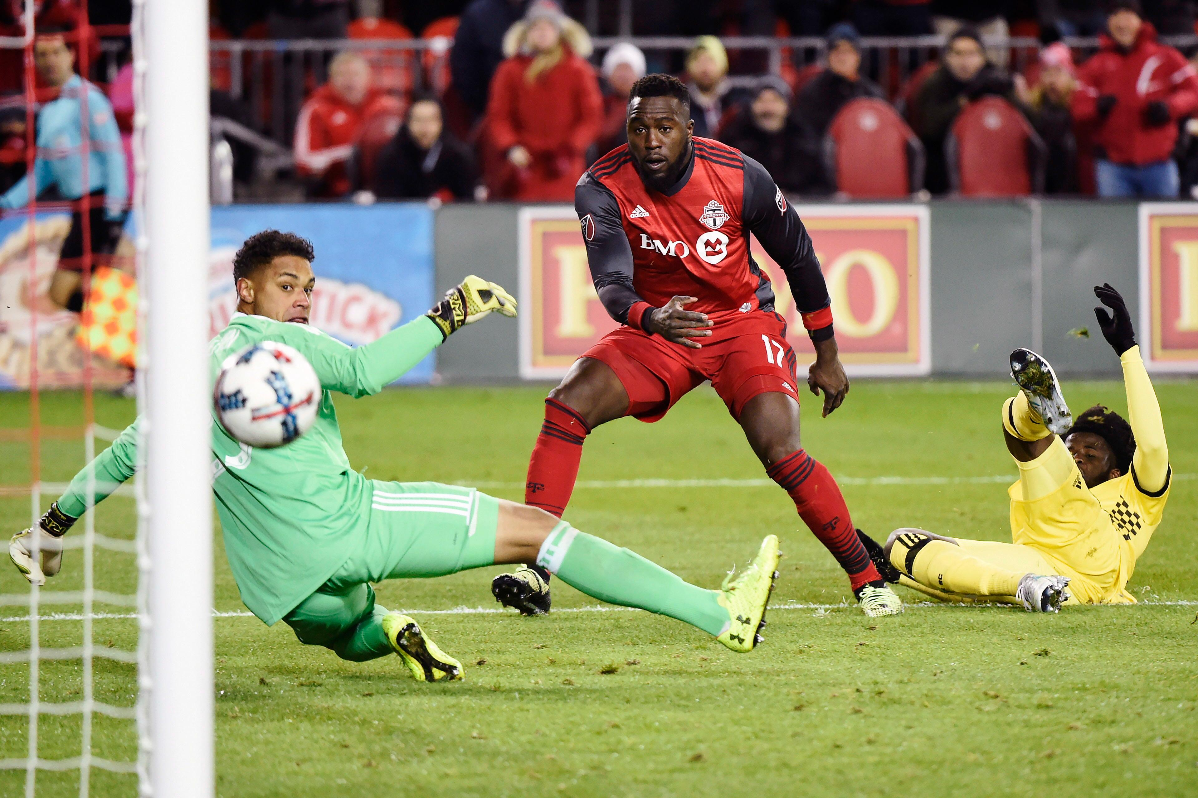 Toronto FC forward Jozy Altidore (17) scores on Columbus Crew goalkeeper Zack Steffen (23) as Crew defender Lalas Abubakar (17) looks on during the second half of an Eastern Conference MLS final playoff soccer game, Wednesday, Nov. 29, 2017 in Toronto. (Nathan Denette/The Canadian Press via AP)