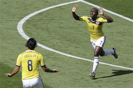 Colombia's Pablo Armero celebrates after scoring during the group C World Cup soccer match between Colombia and Greece at the Mineirao Stadium in Belo Horizonte, Brazil, Saturday, June 14, 2014.