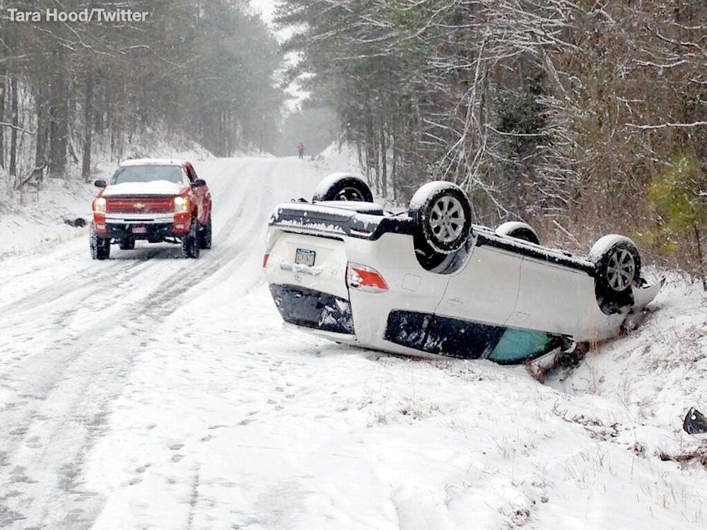 A Toyota highlander flipped over off of Pleasant Valley Road in Calhoun County. No one was injured. A strong winter storm wreaks havoc across Alabama with snow and ice, Tuesday, January 28, 2014.